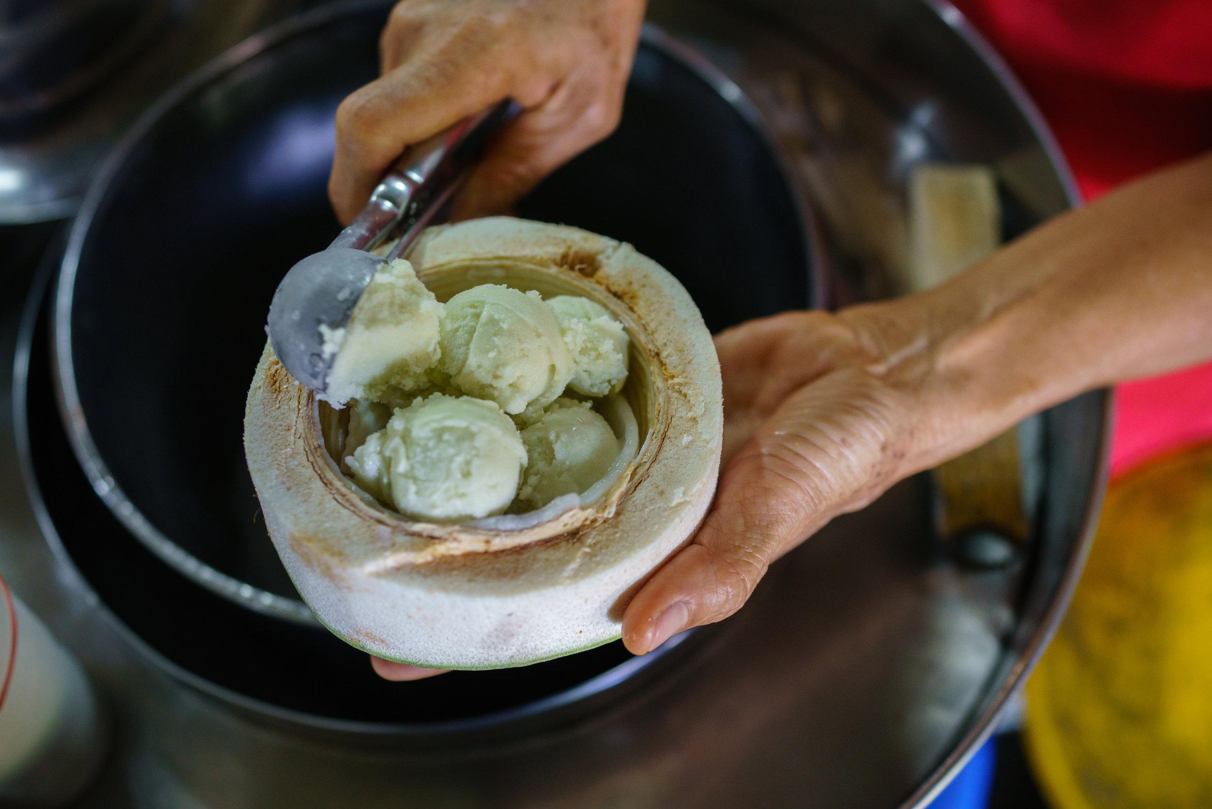 Refreshing coconut ice cream on a hot day, at Khlong Lat Mayom Floating Market