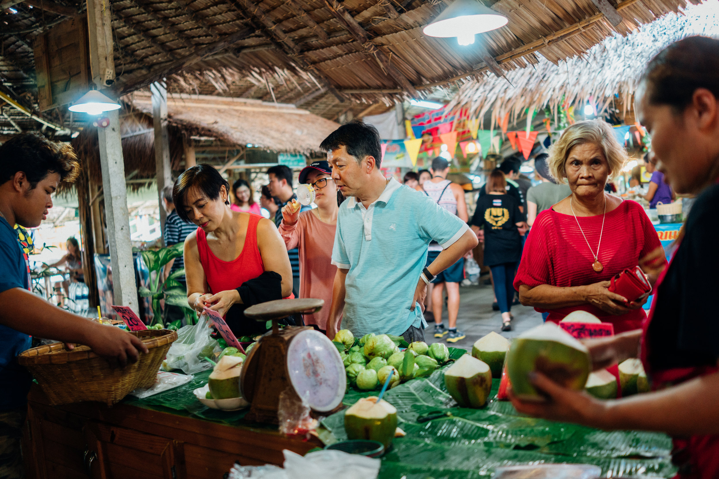 Fresh coconut water is always refreshing on a hot day, pictured here at Khlong Lat Mayom Floating Market