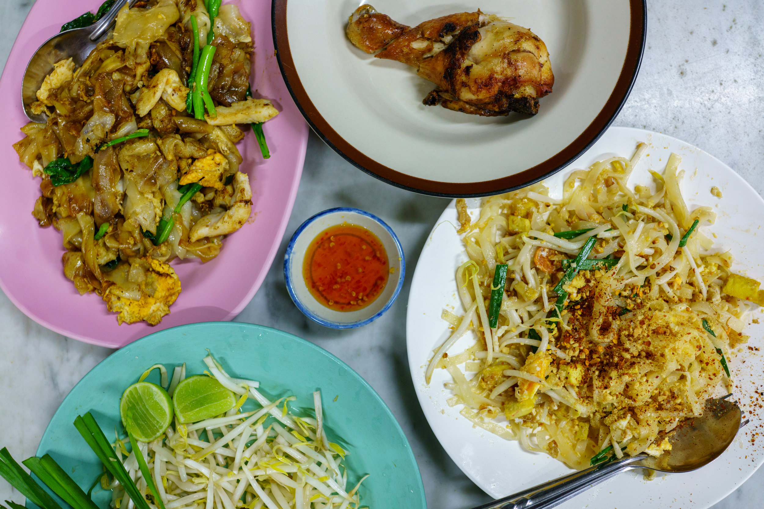Pad see ew , gai yang , and  pad Thai  make a complete meal