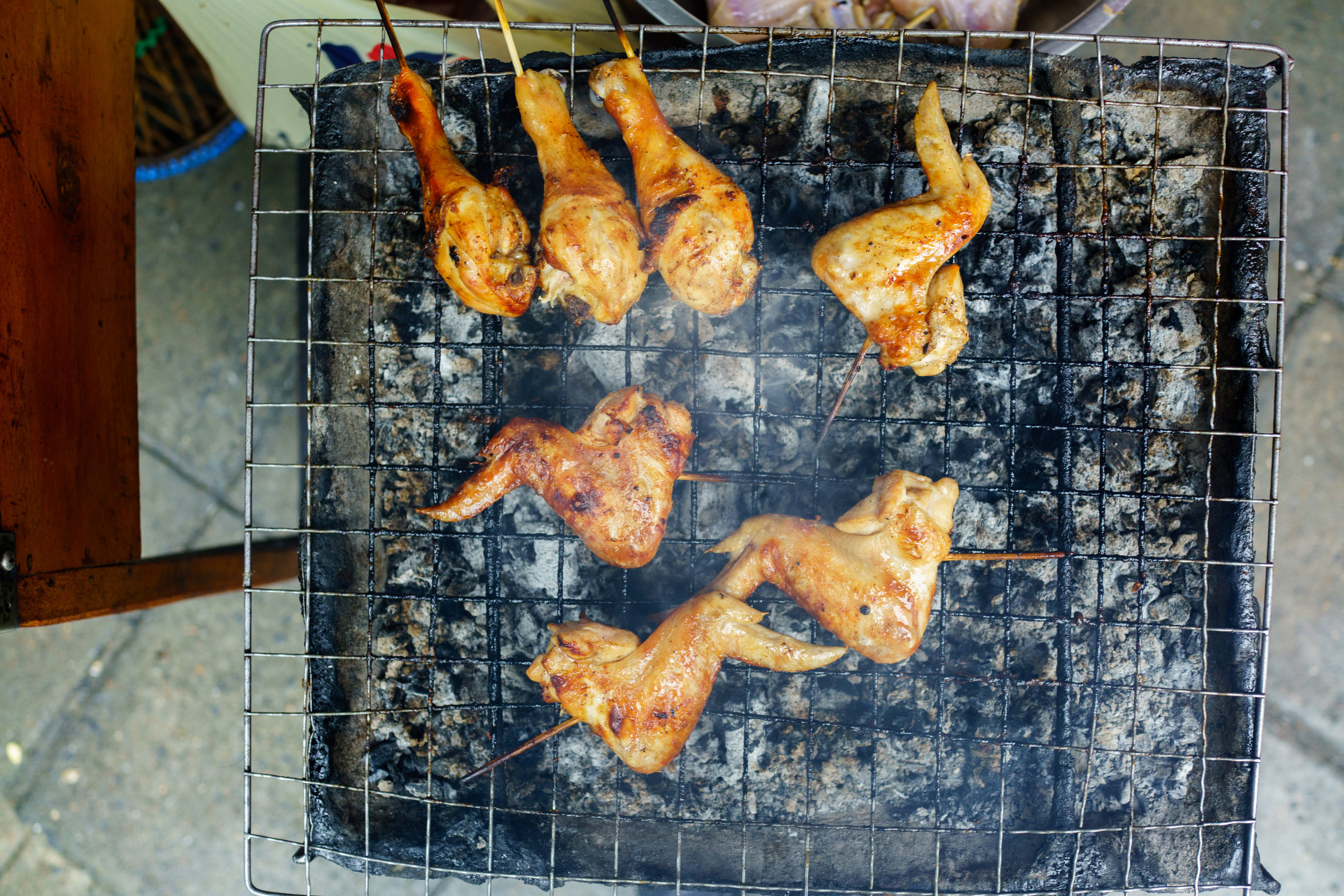 Gai yang  - chicken slow-roasting over charcoal
