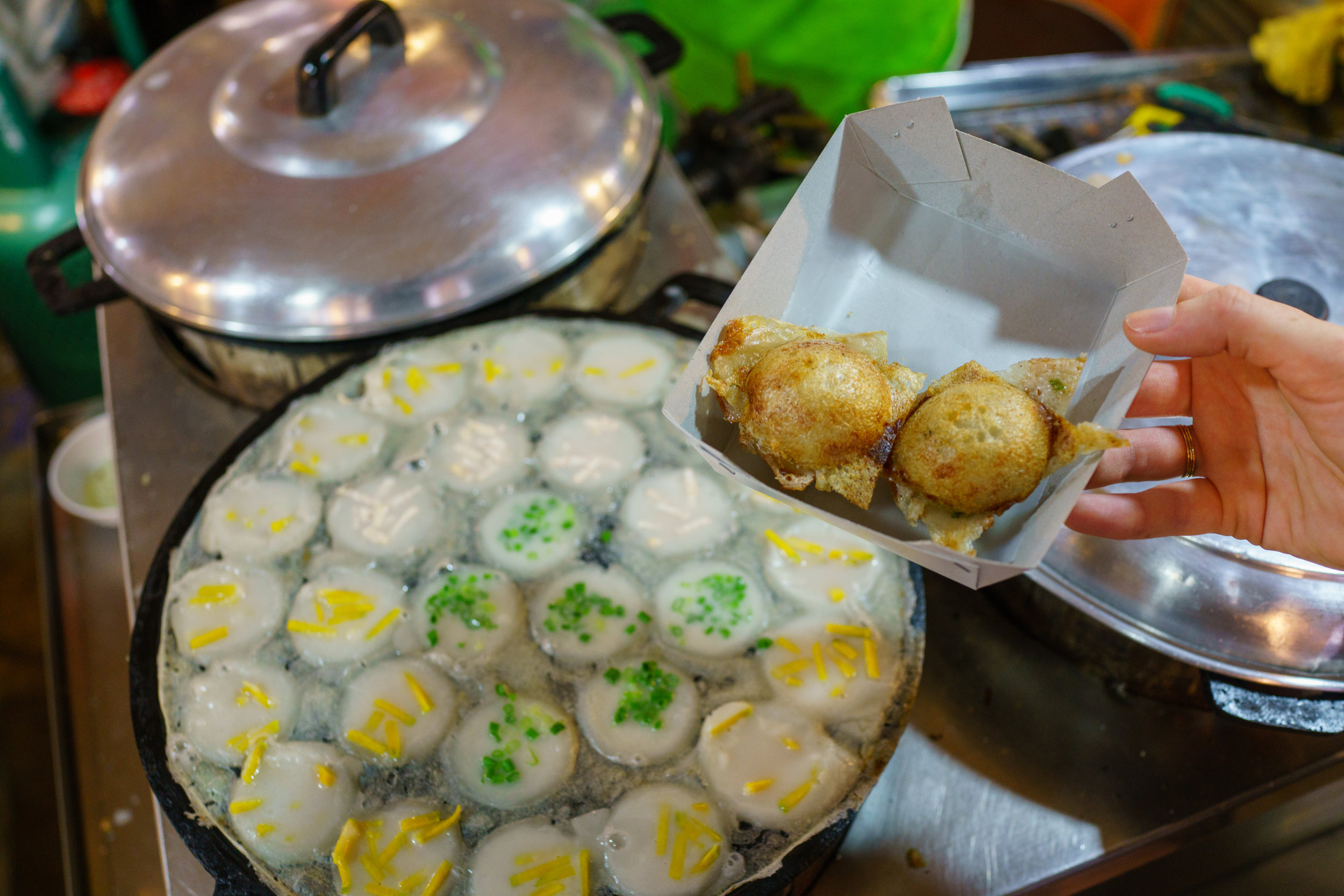 Kanom krok are considered a sweet, but are made with some savory ingredients