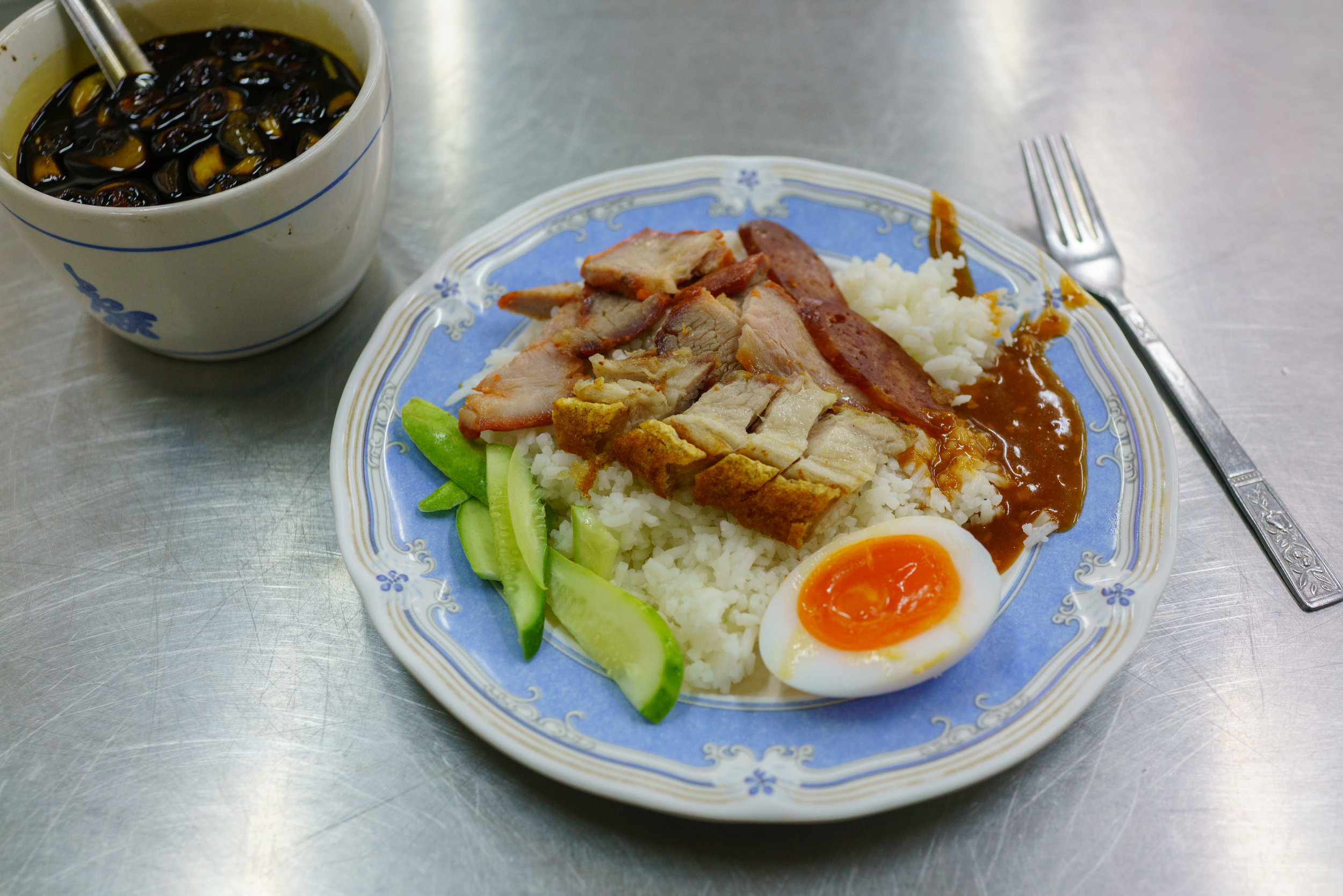 A simple plate of Thai red pork with rice for lunch
