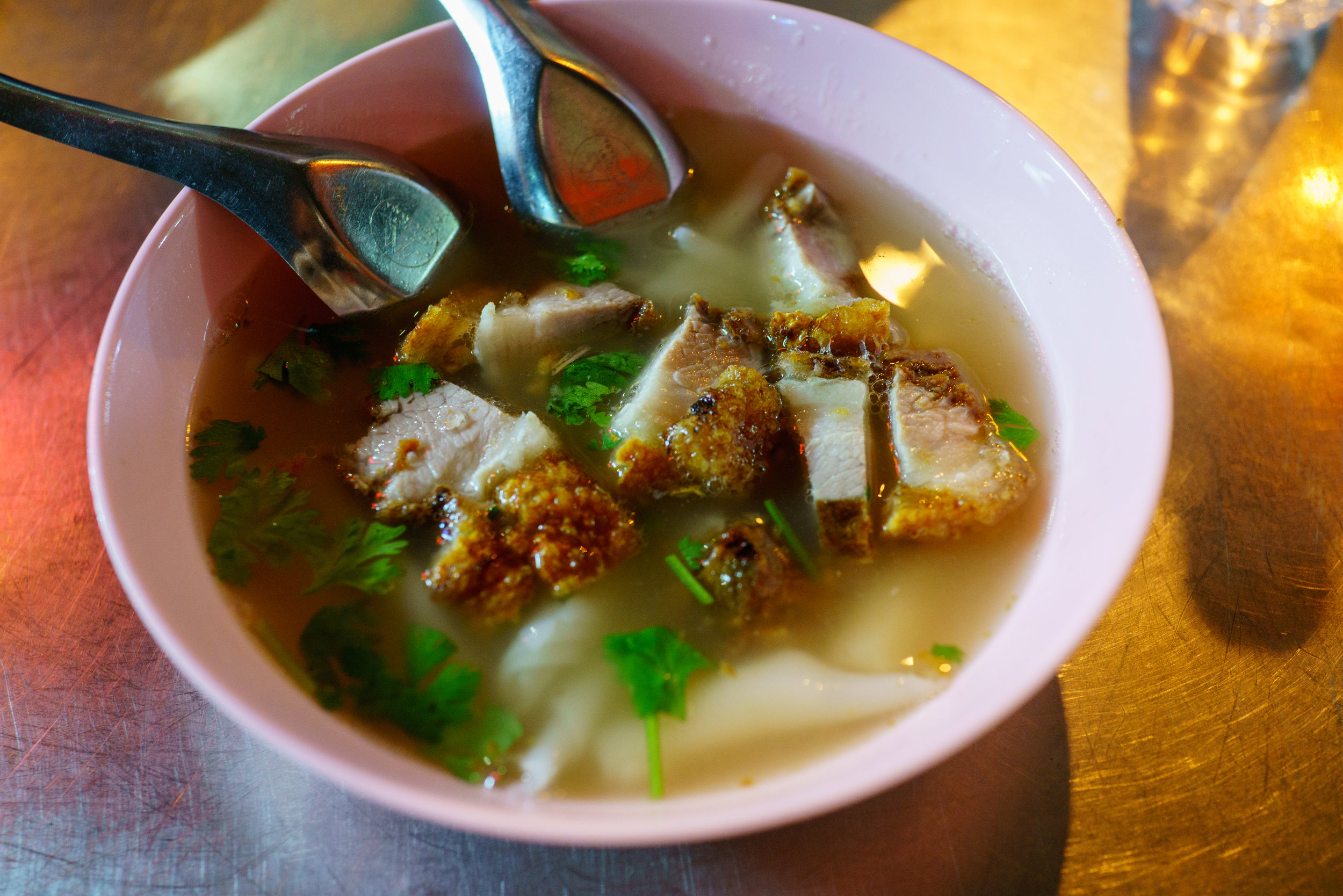 Delicious bowl of  kuay jap nam sai , clear broth pork soup, in Bangkok's Chinatown