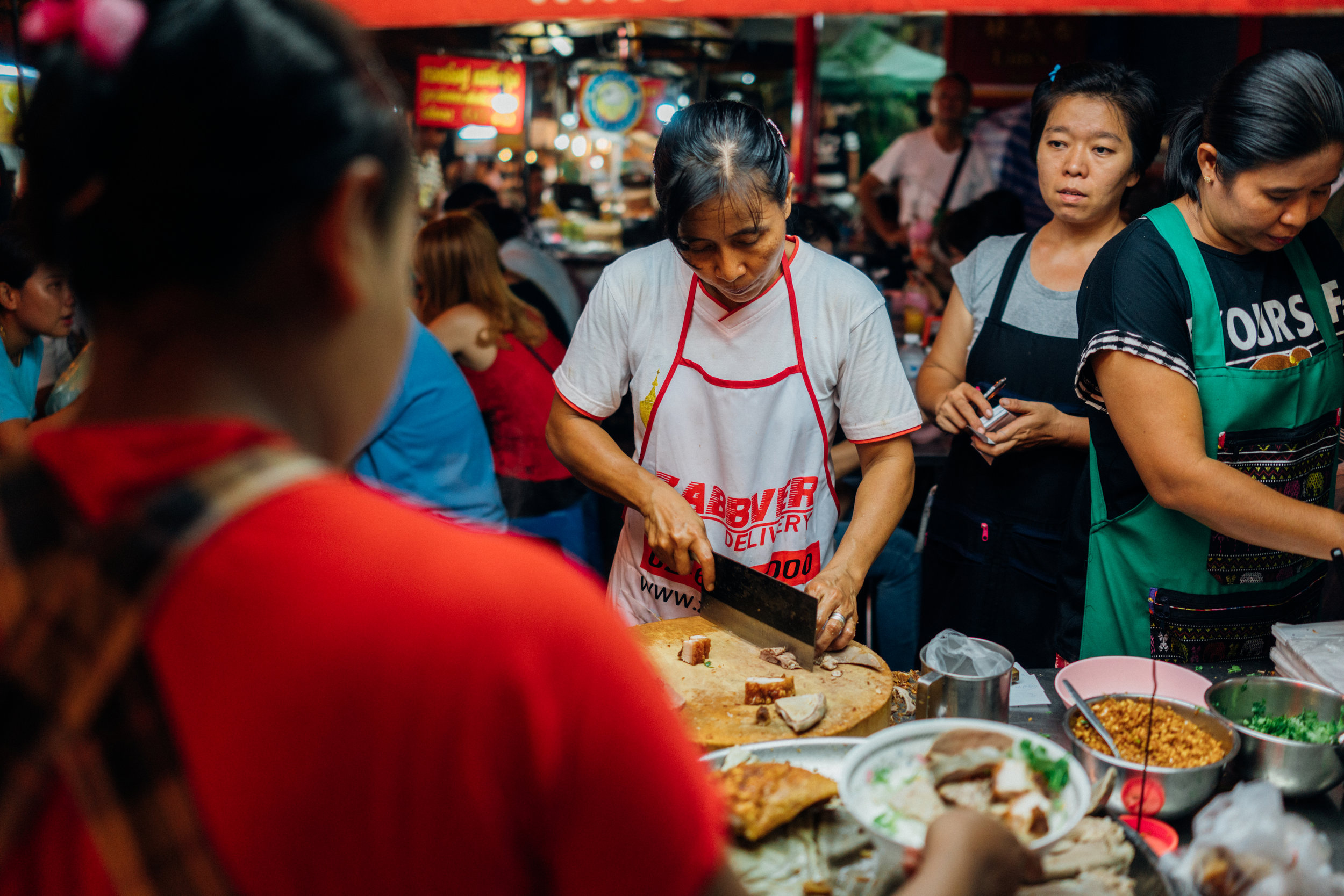 Impressive assembly line at the busy  Kuay Jab Nay Lek  on a busy Sunday night in Bangkok's Chinatown