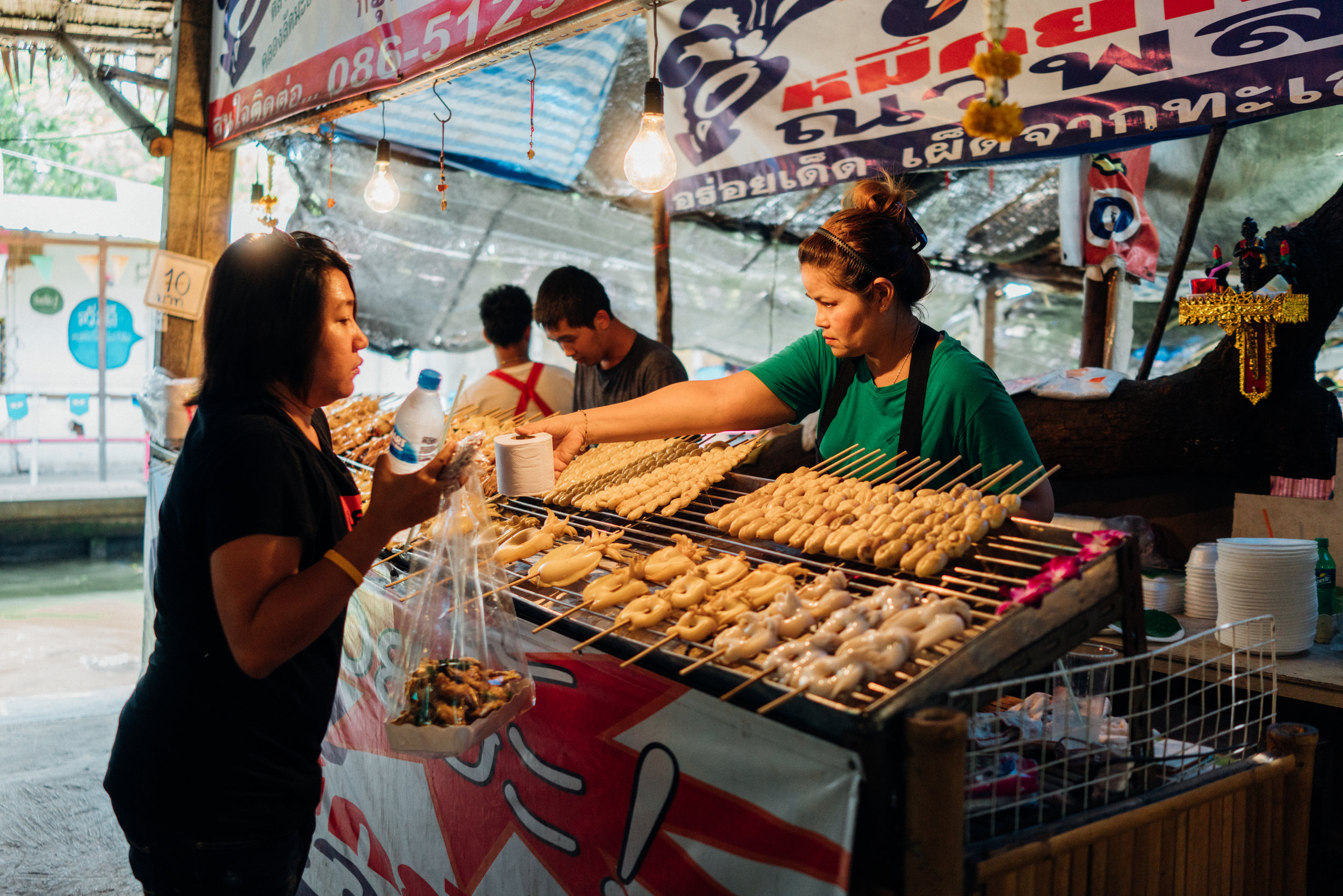 Meat and fish on skewers is a common snack in Bangkok