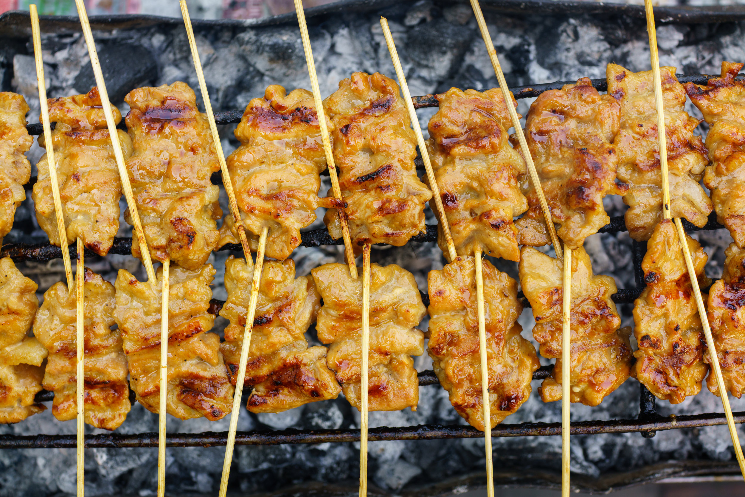 Pork skewers and sticky rice make a great snack