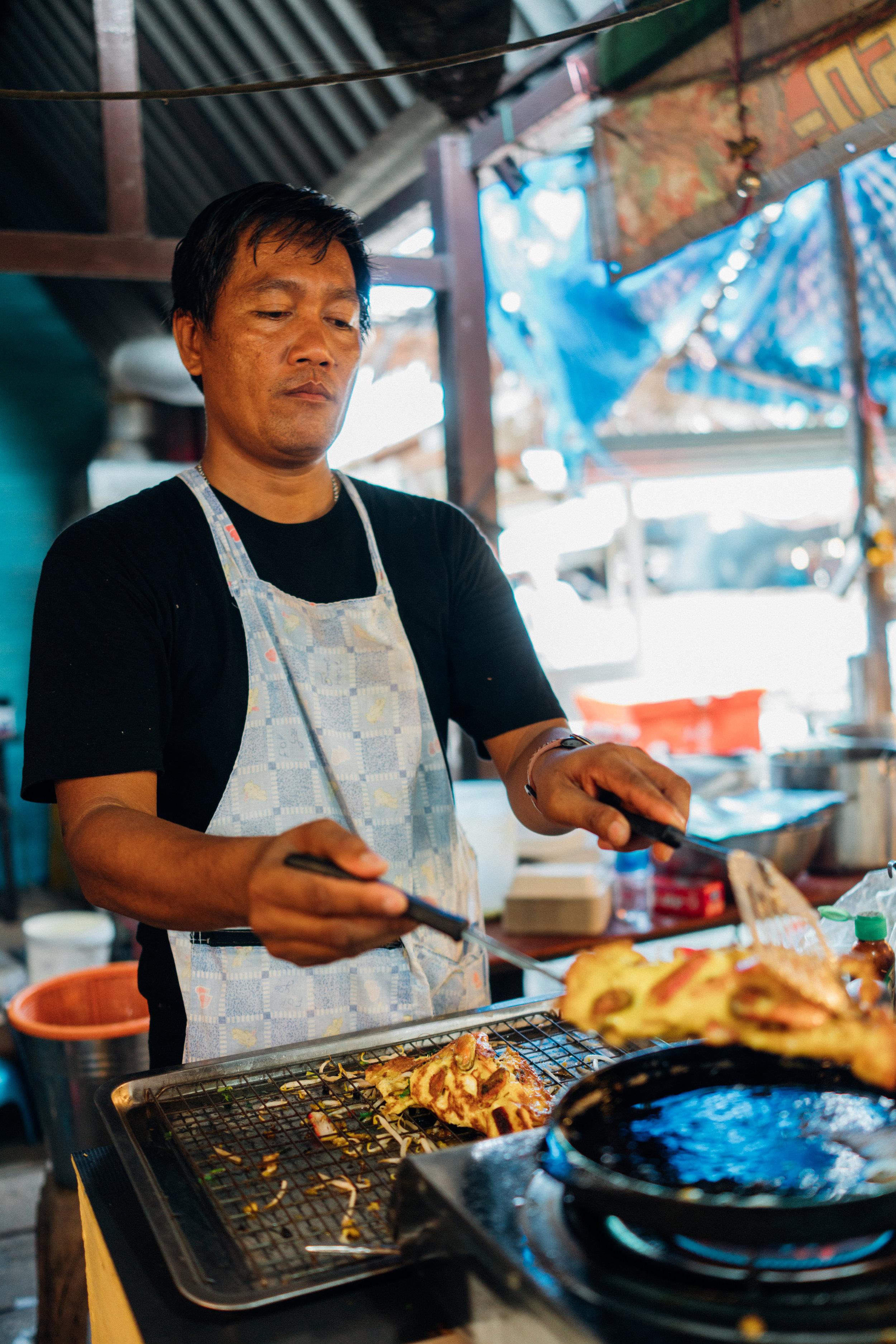 A vendor at  Khlong Lat Mayom Floating Market