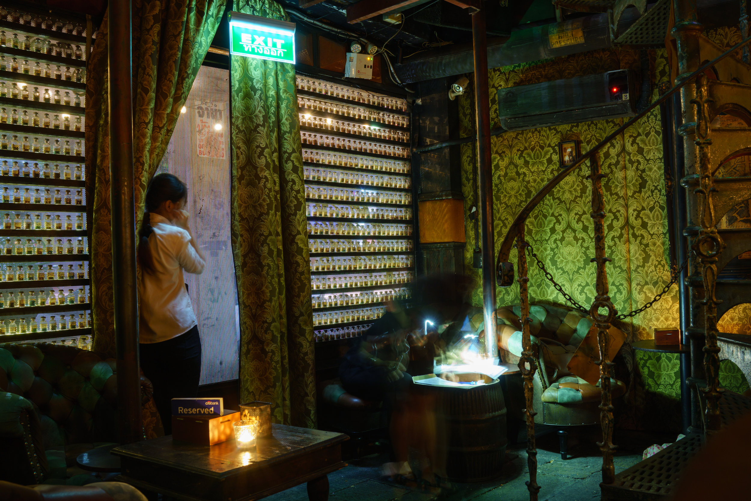 The entrance to The Iron Fairies in Bangkok is lined with small vials of fairy dust