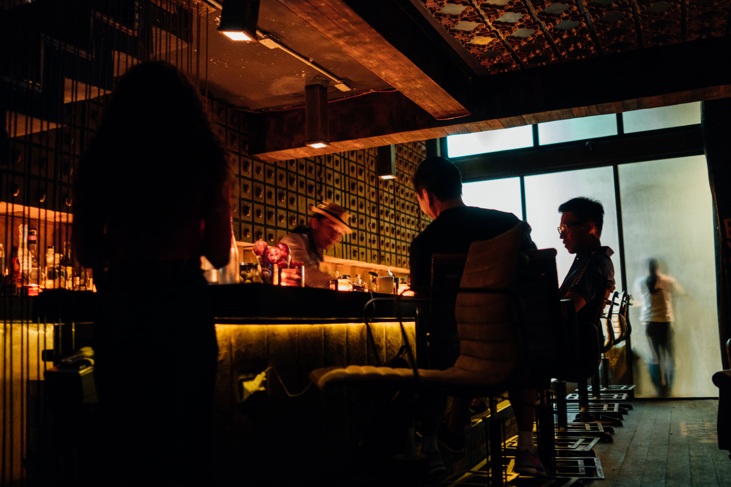 The bar at J. Boroski Mixology in Bangkok, as seen from our plush leather chairs