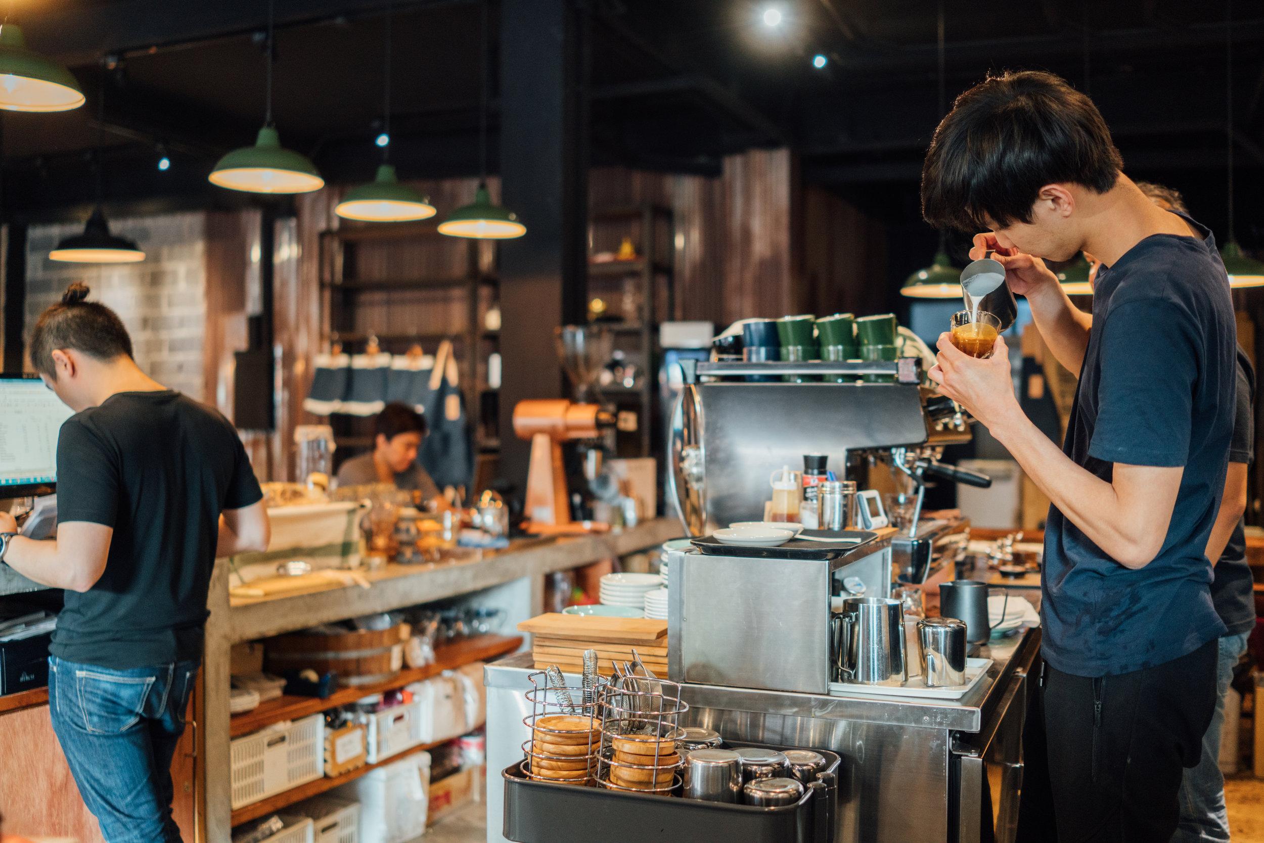 Making latte art at Factory Cafe in Bangkok