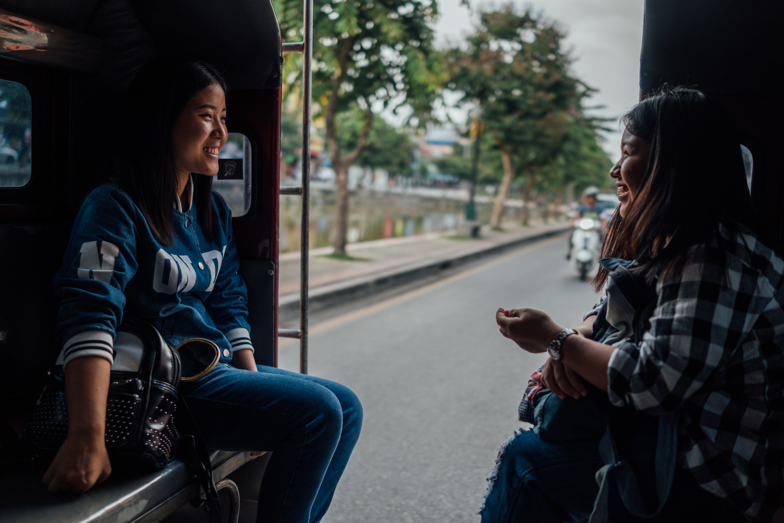 Beautiful smiles during a  songthaew  ride