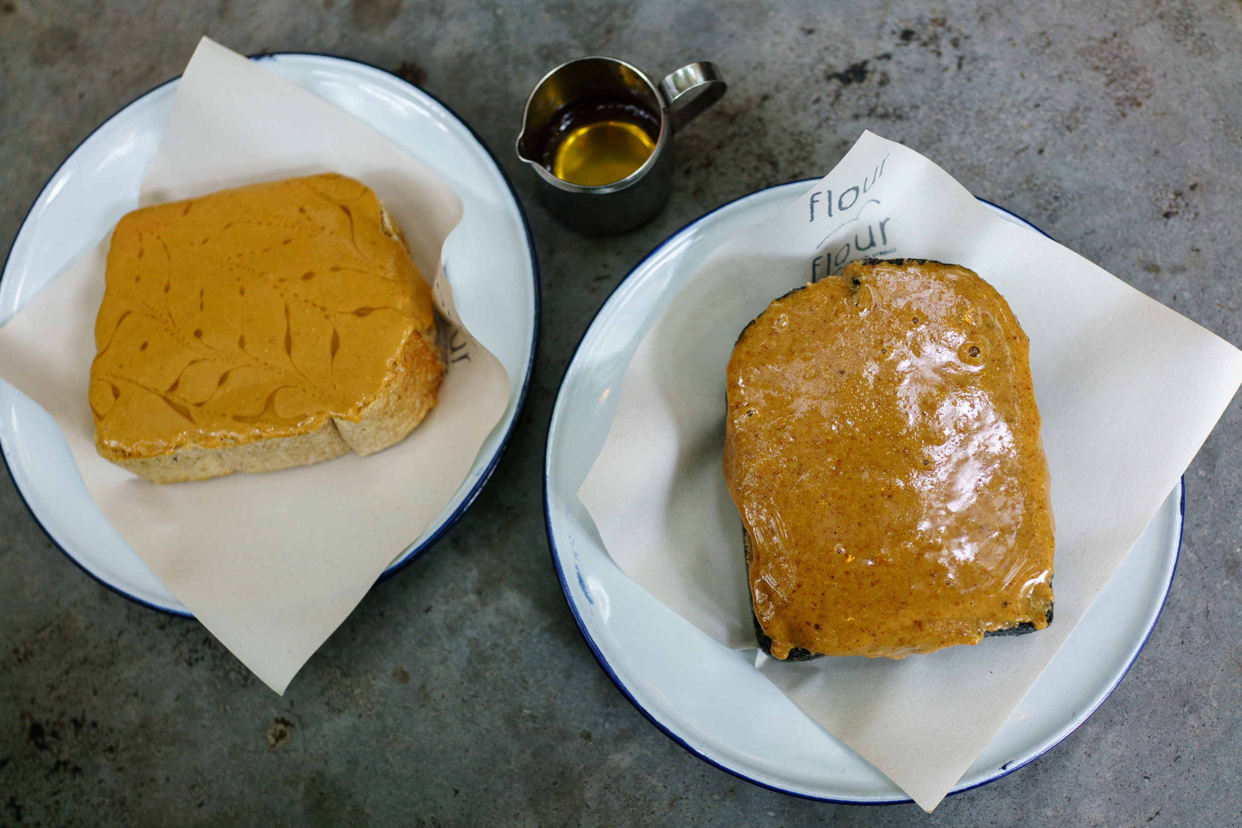 Whole wheat toast with homemade Peanut Butter and honey; Charcoal toast with homemade Almond Butter