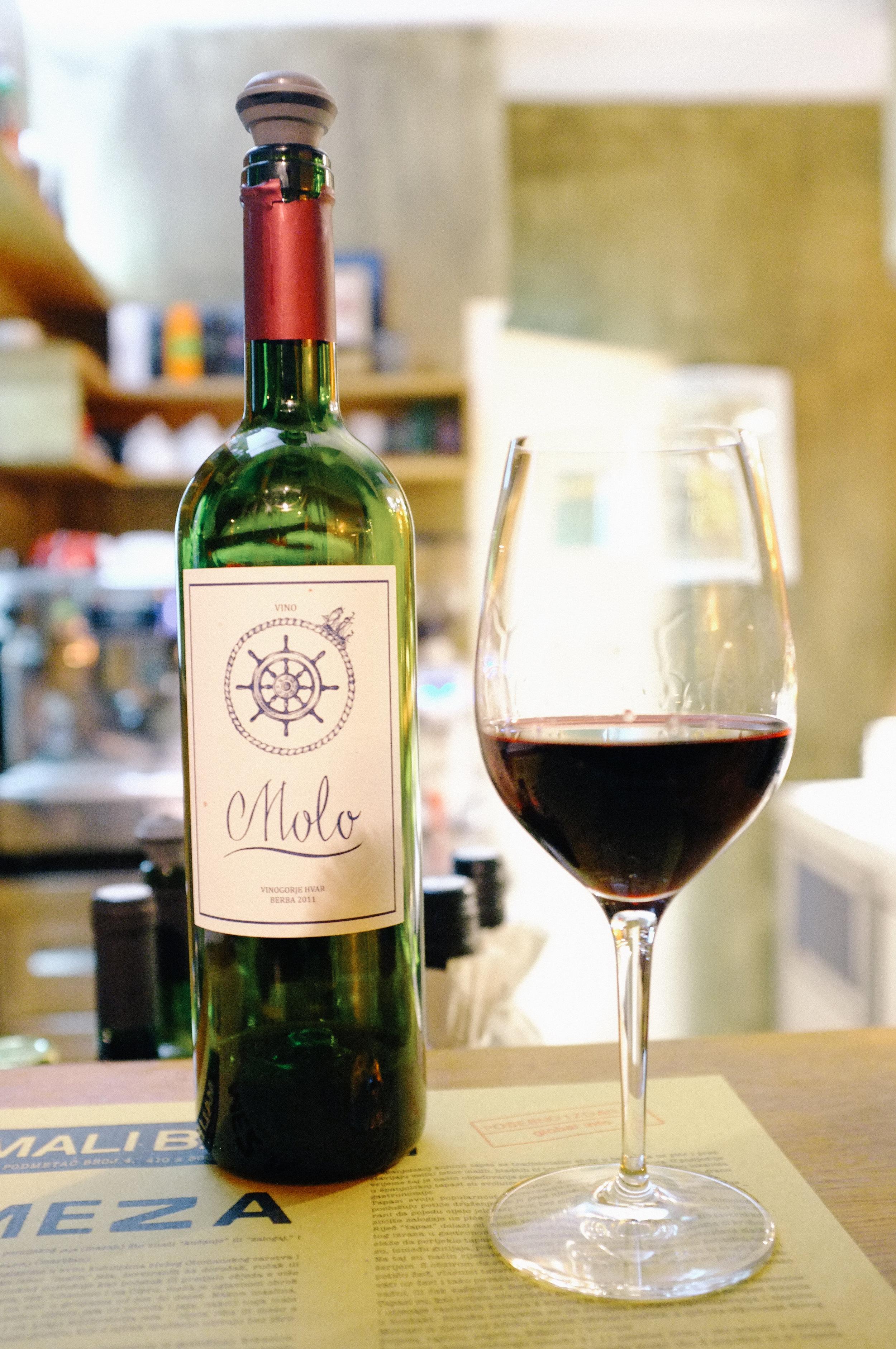 A glass of local, Croatian wine at Mali Bar
