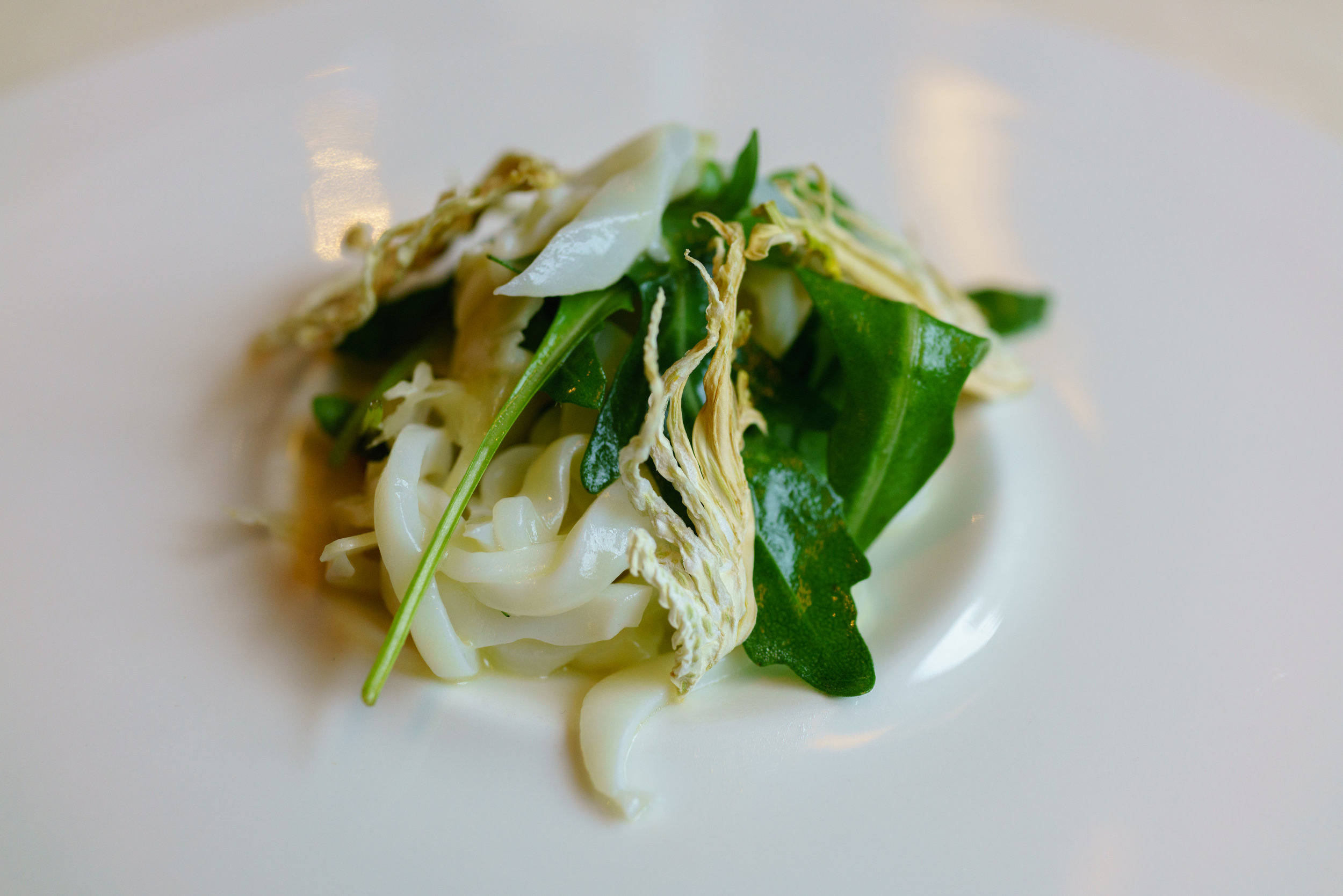 Cuttlefish, fennel, chickpeas, red lentils, rocket leaf, spiked with chili
