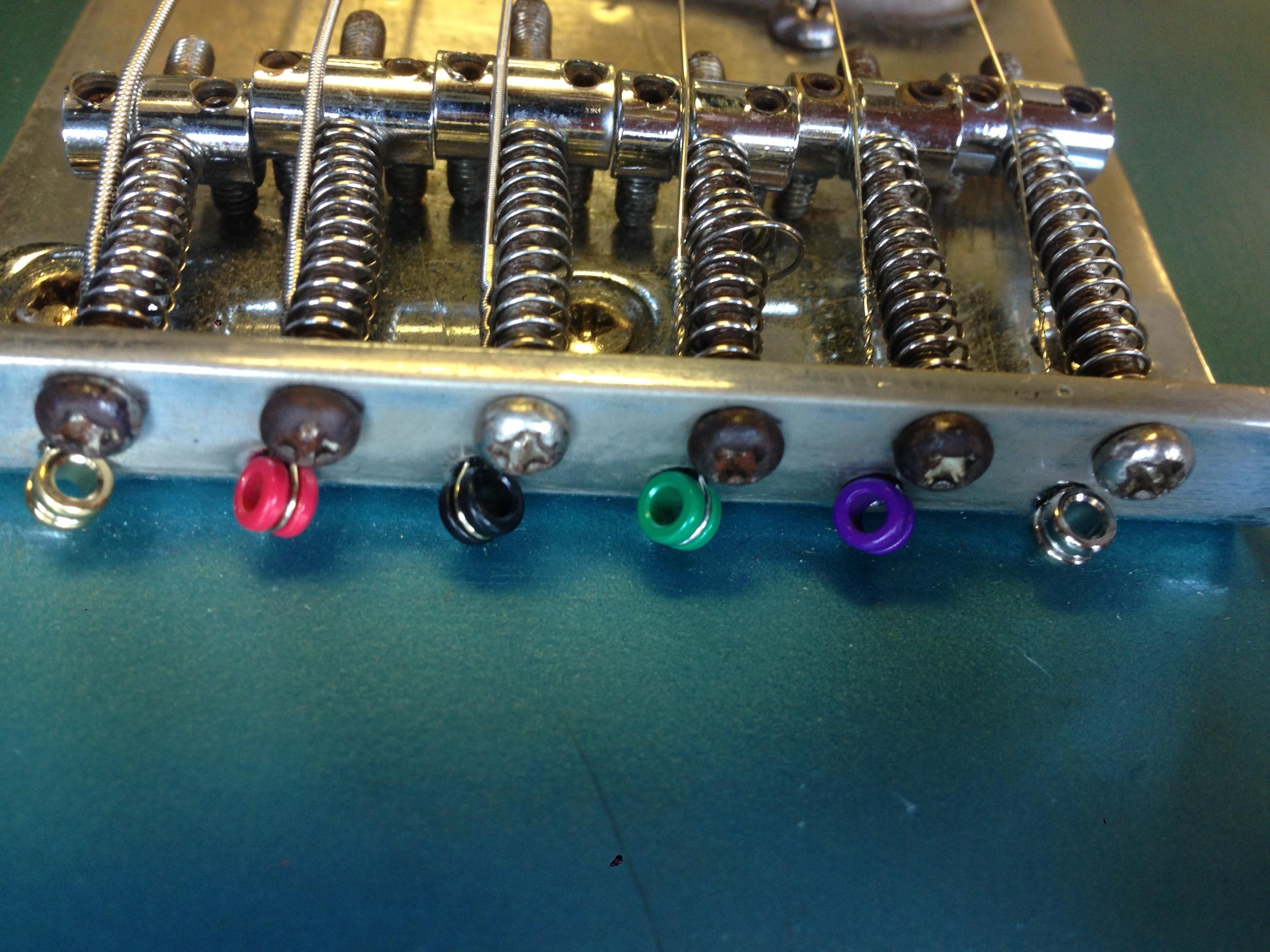 Saddles and adjustment screws
