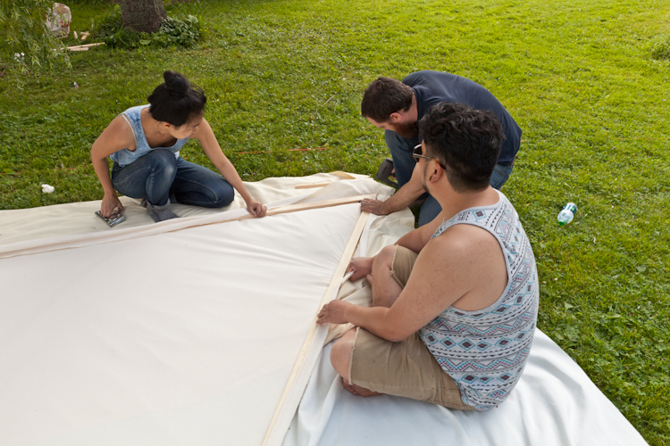 Stretching the fabric for the roof pieces.