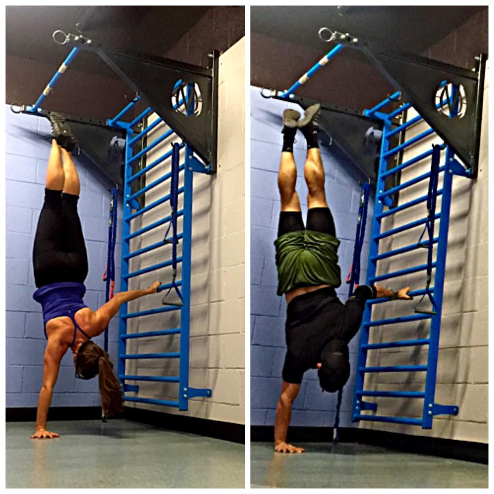 One arm handstand is very challenging and using the stall bars can help you find balance