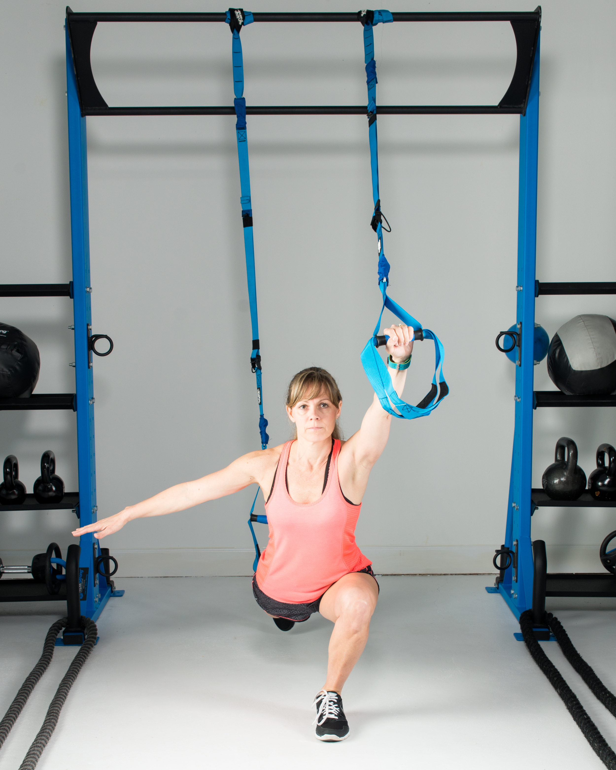 Lunge to press suspension exercise