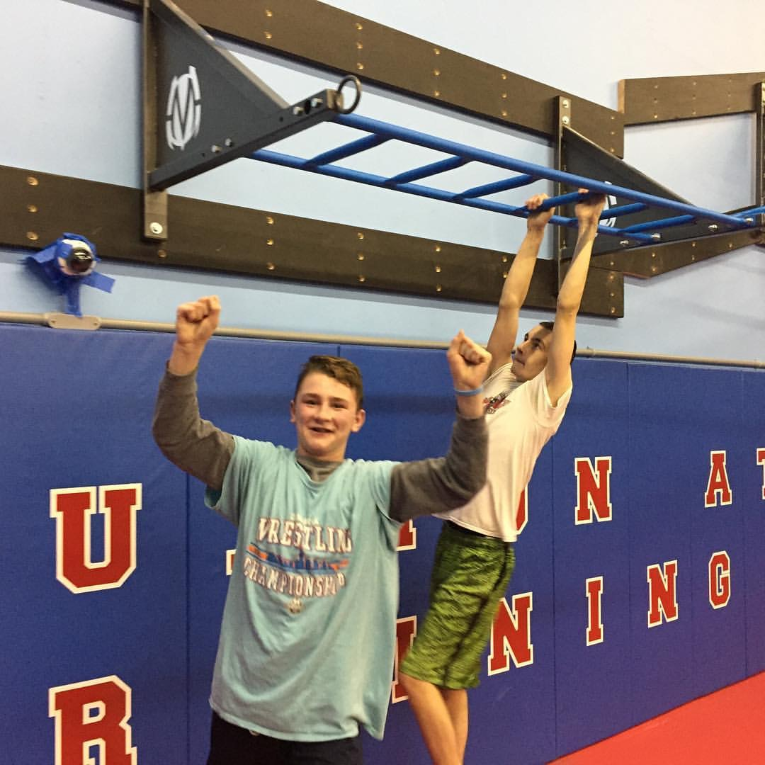 Wrestling practice grip bar climb