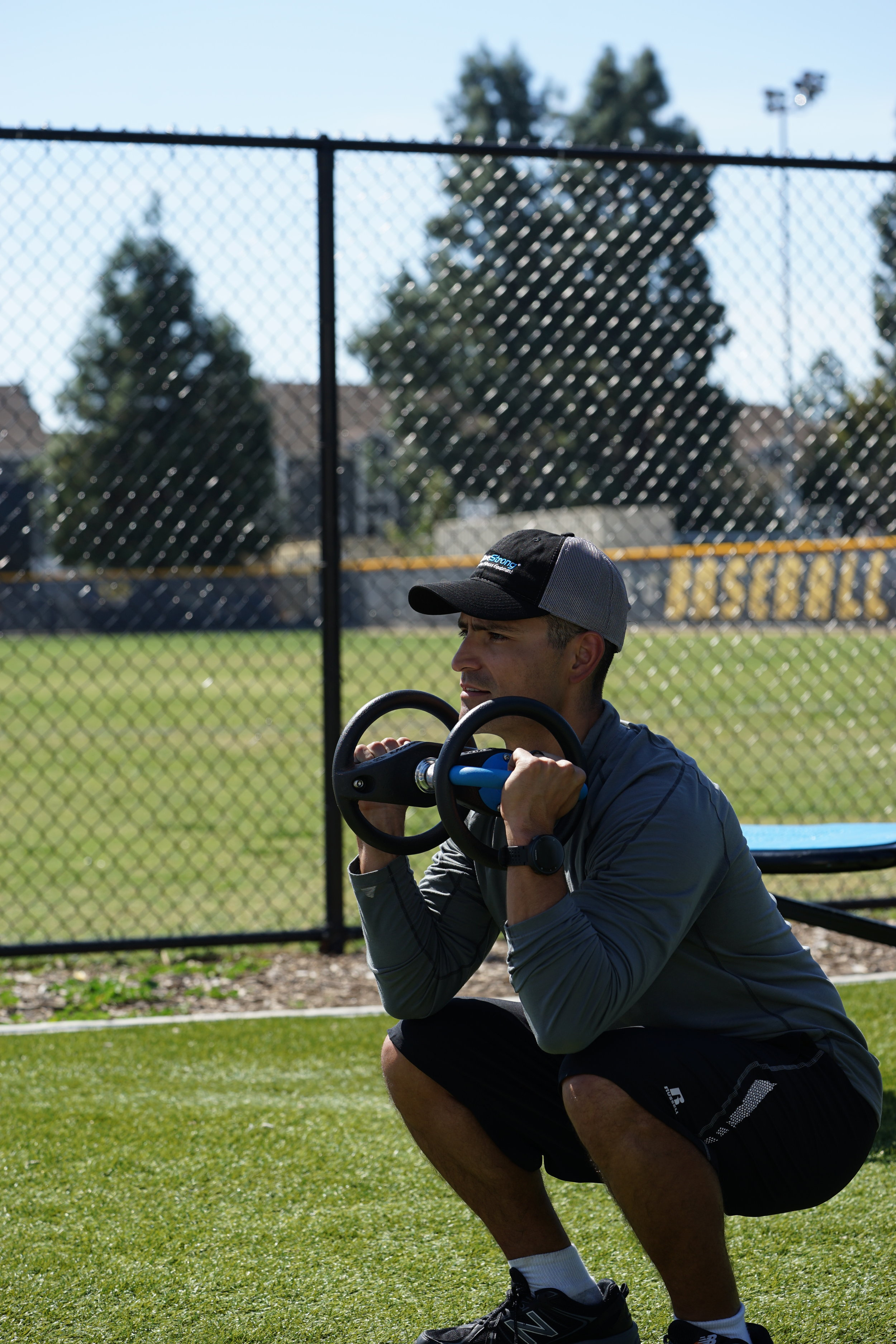 DyanBell thruster squat