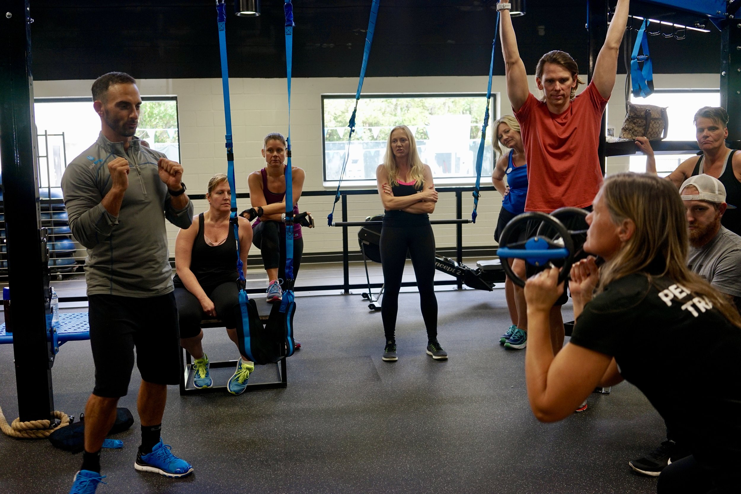 Teaching DynaBell squat-to-press