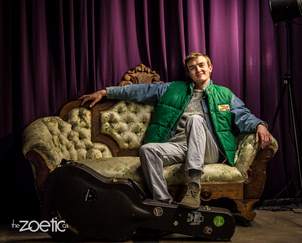 Singer-songwriter Kashew Butter chilling next to his guitar on the 1840s sofa in the lobby.