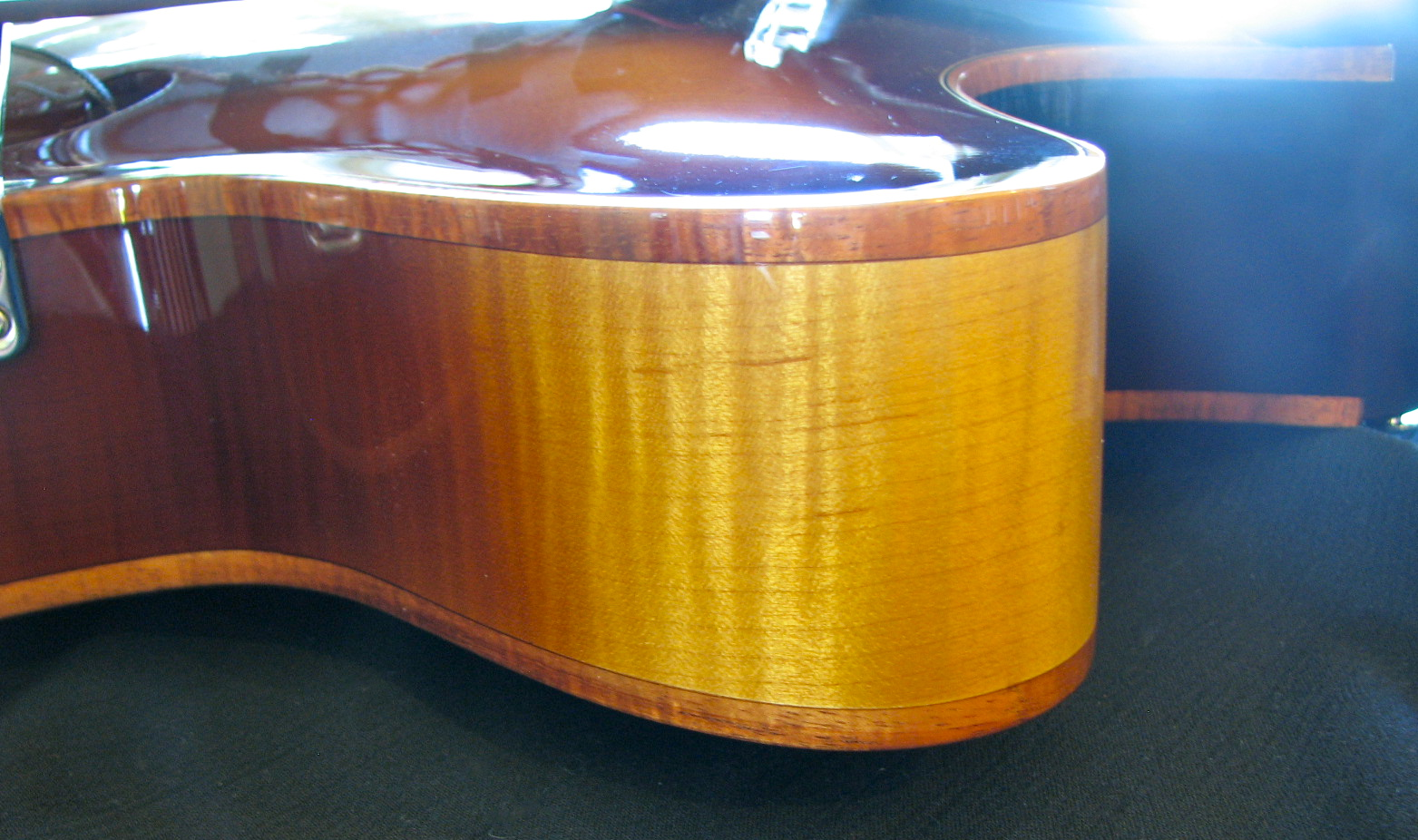 The cutaway horn of CB's maple burst Corvette archtop.