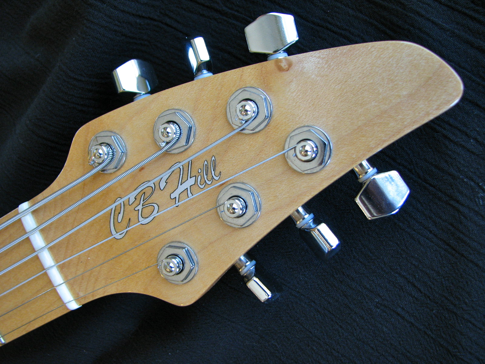 The paintbrush headstock puts the Sperzel locking tuners in the optimal positions