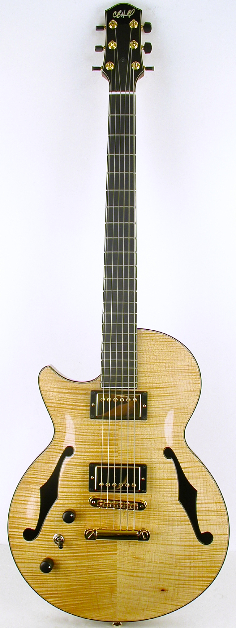 A rare lefty 2-5-1 in natural flame maple