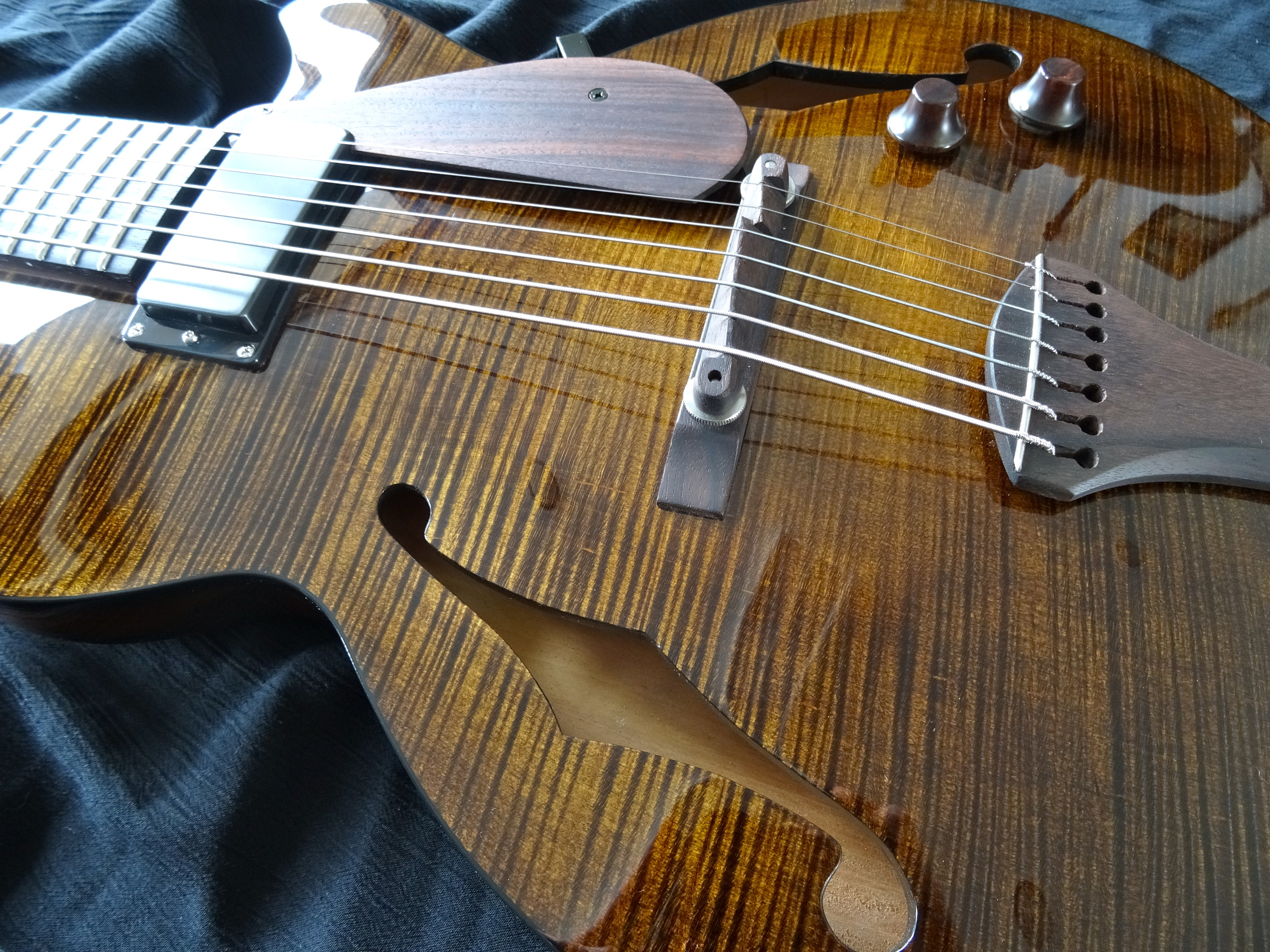 The stain was hand-applied, the finish is nitrocellulose.