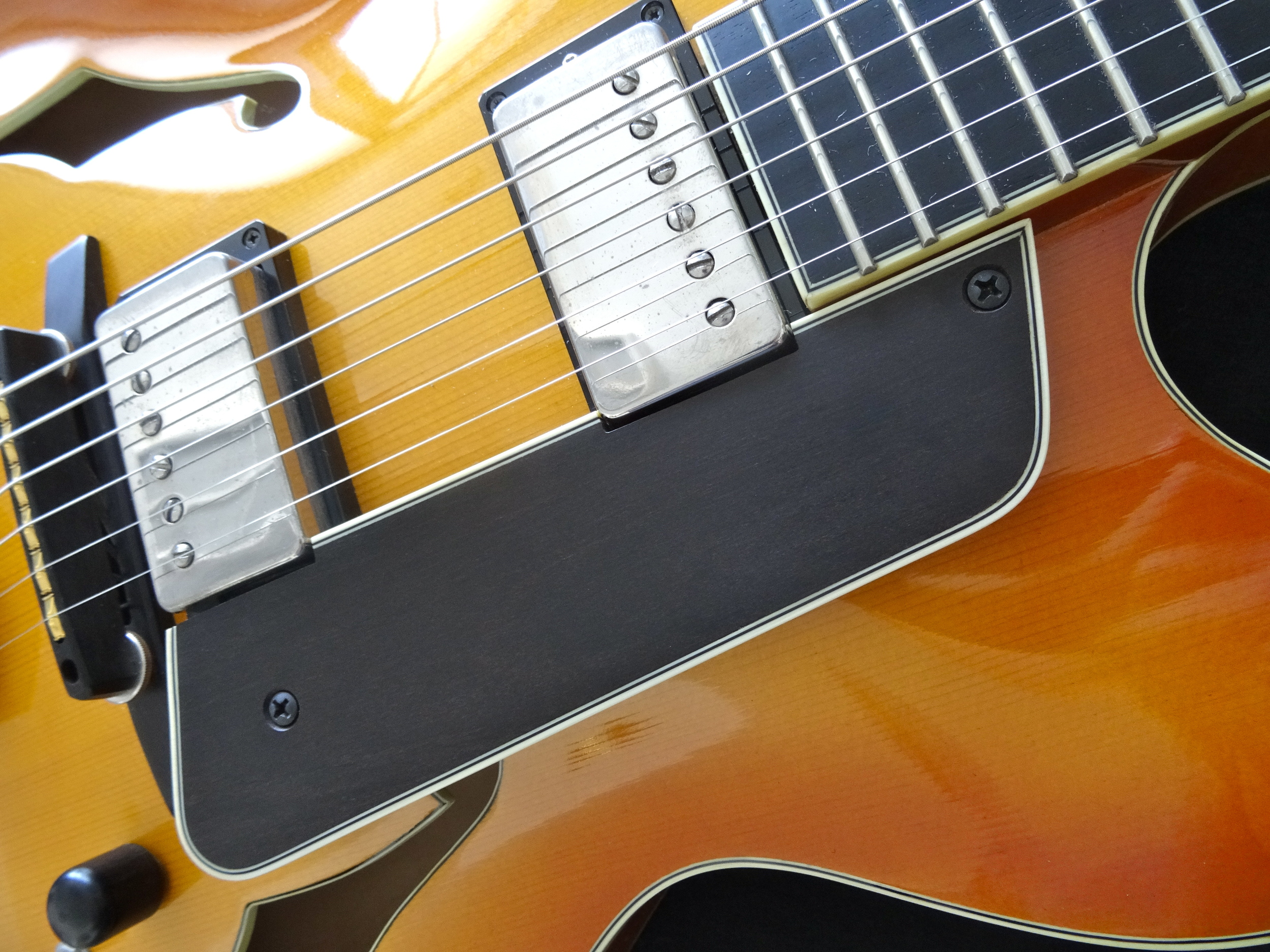 All the fixtures are still handmade by CB, including the bound ebony pickguard