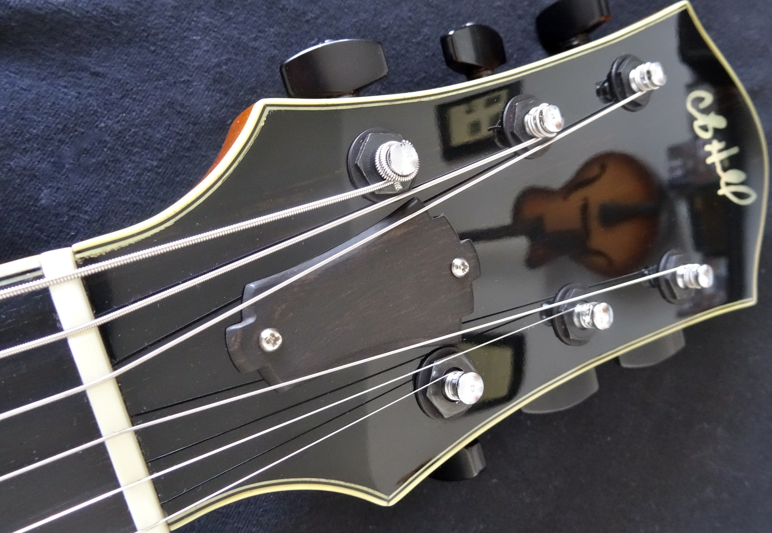 The headstock reflects well on CB's craftsmanship