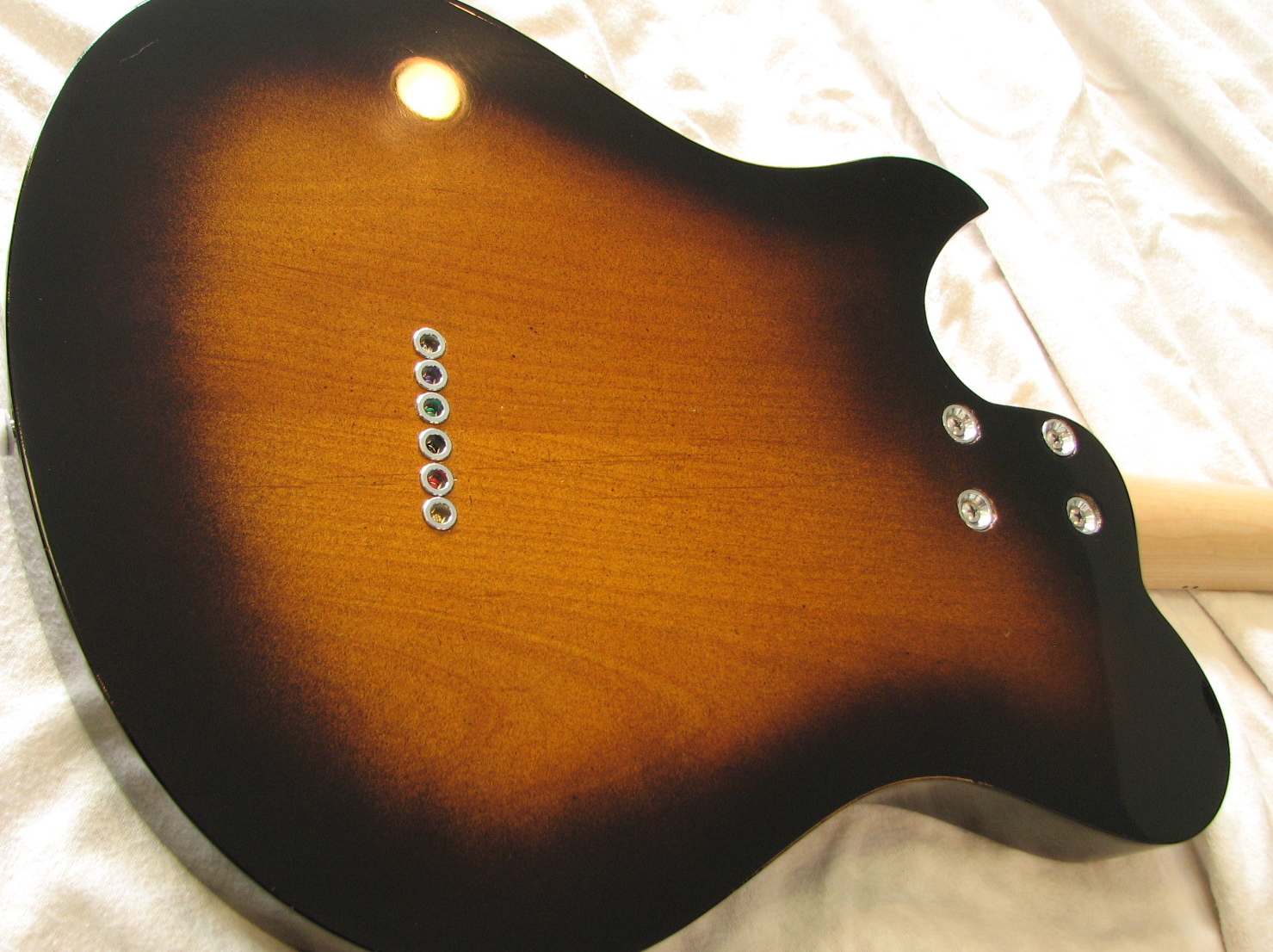 The black edge burst is reminiscent of the old Kay guitars that CB loves