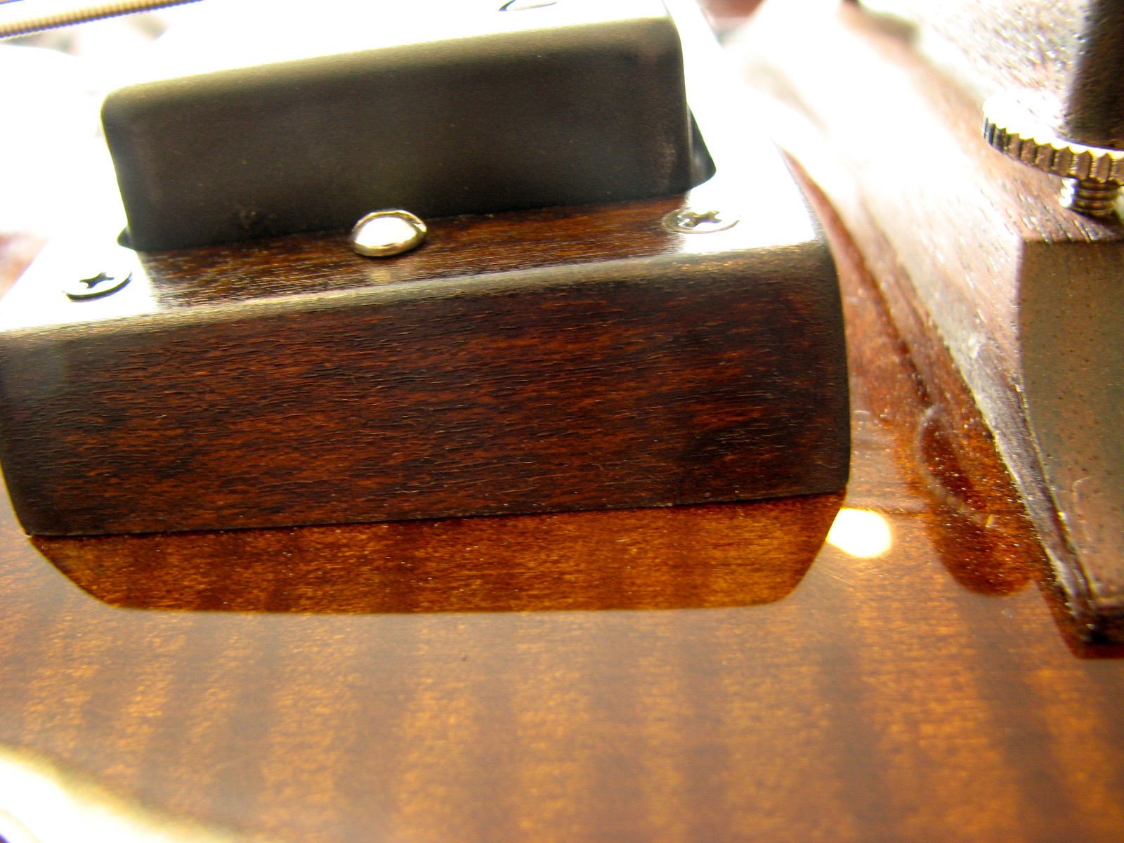 The pickup surrounds are handmade by CB