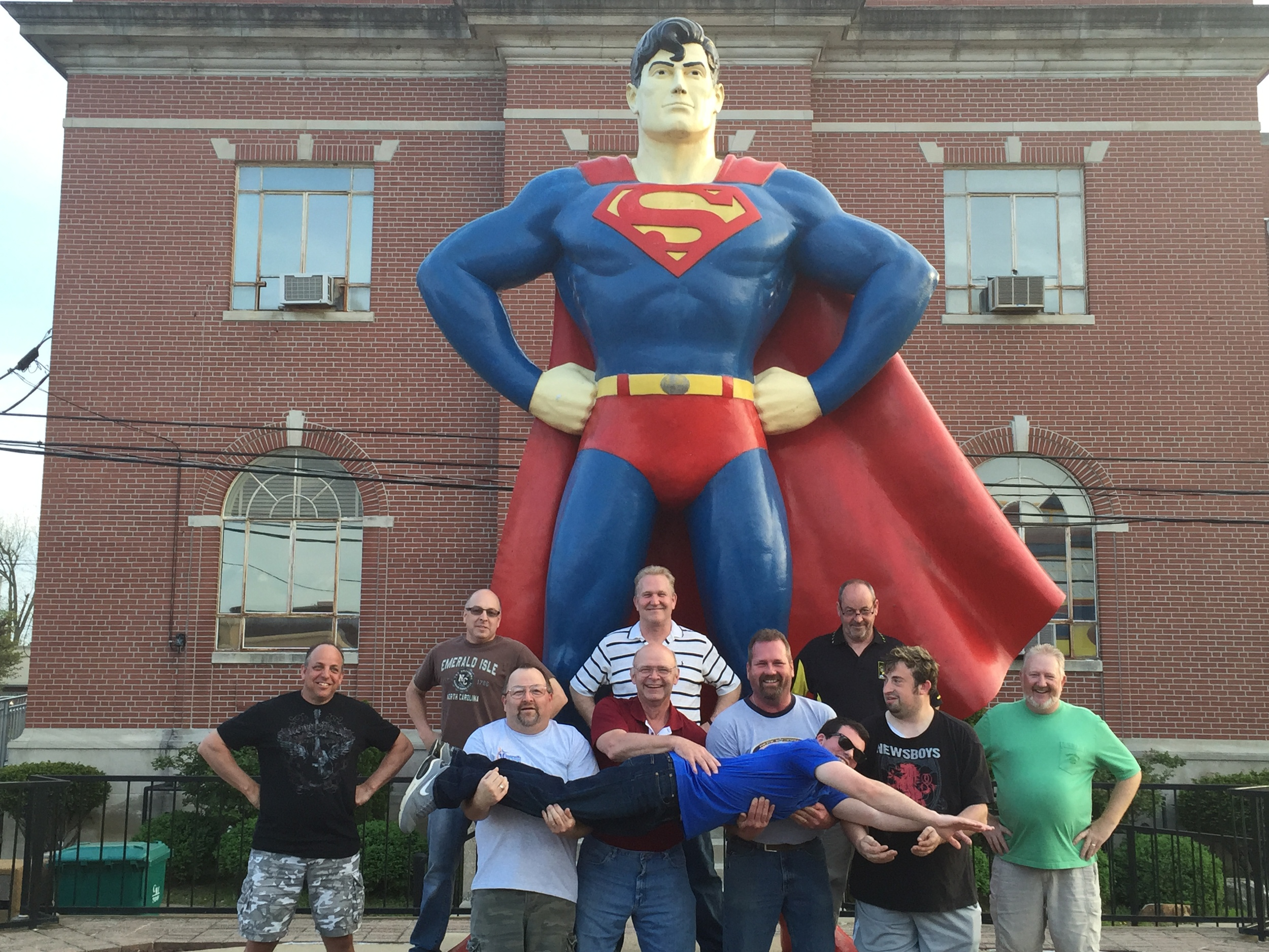 Part of the team in front of the thirty foot Superman statue in Metropolis, IL.