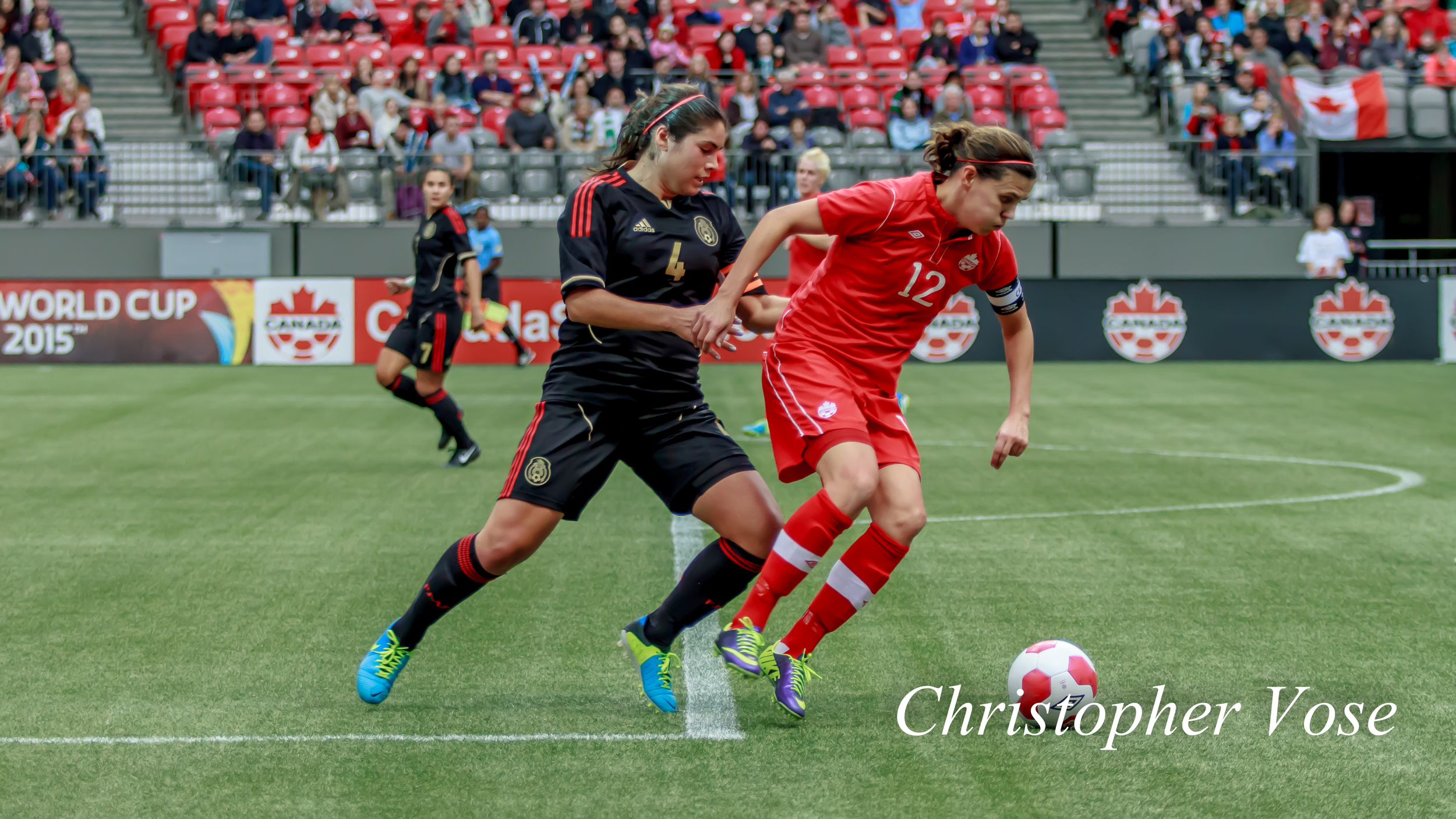 2013-11-24 Alina Garciamendez and Christine Sinclair.jpg