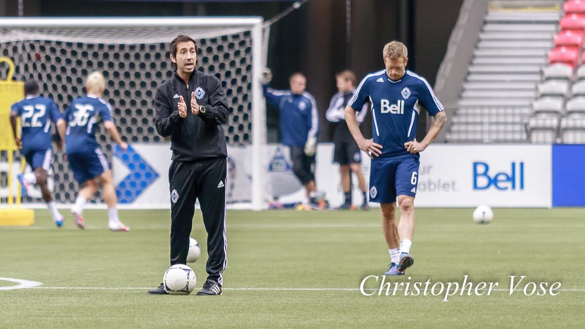 Martin Rennie coachesas Jay DeMerit takes a momentduring Vancouver Whitecaps FCtrainingat BC Place on 7 June 2012.