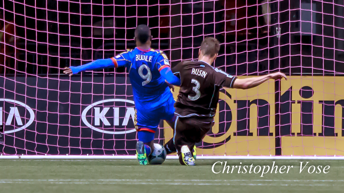Brad Rusin saves a certain Edson Buddle goal at BC Place on 27 October 2013.