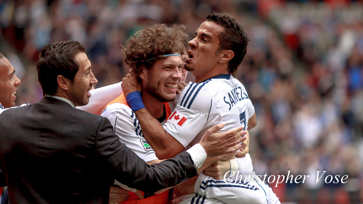 Camilo Sanvezzo embraces Tom Heinemann after scoring at BC Place on 18 May 2013.
