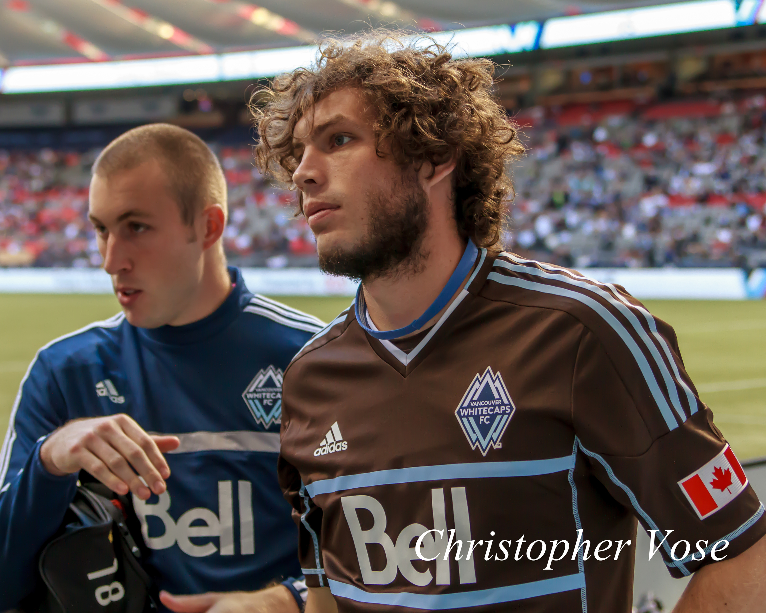 Brad Knighton (deep sea) and Tom Heinemann (arbutus brown) add some colour to the white of BC Place on 27 October 2013.