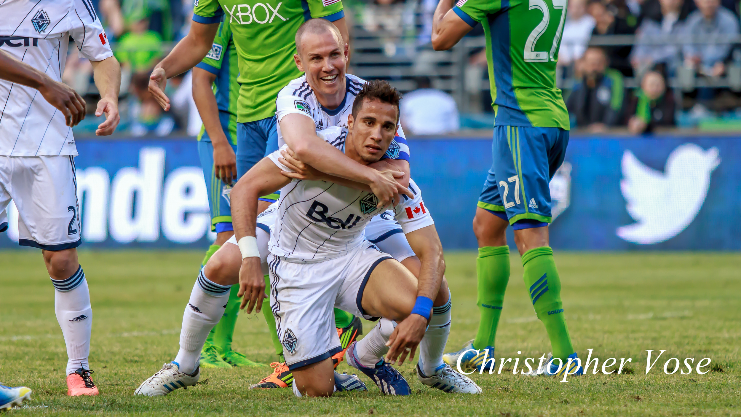 Kenny Miller celebrates with Camilo Sanvezzo after O Mágico's goal at CenturyLink Field on 8 June 2013.
