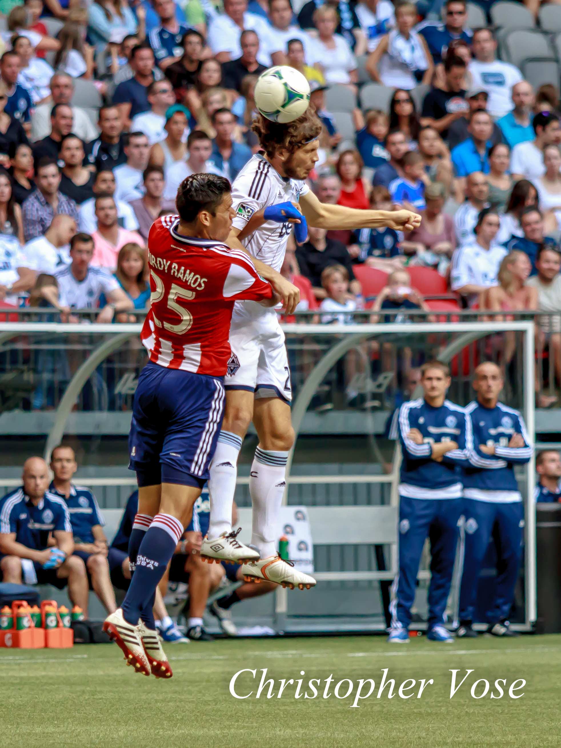 No matter how hard CD Chivas' Steven Purdy tried, he couldn't stop Vancouver Whitecaps FC's Tom Heinemann at BC Place on 1 September 2013.