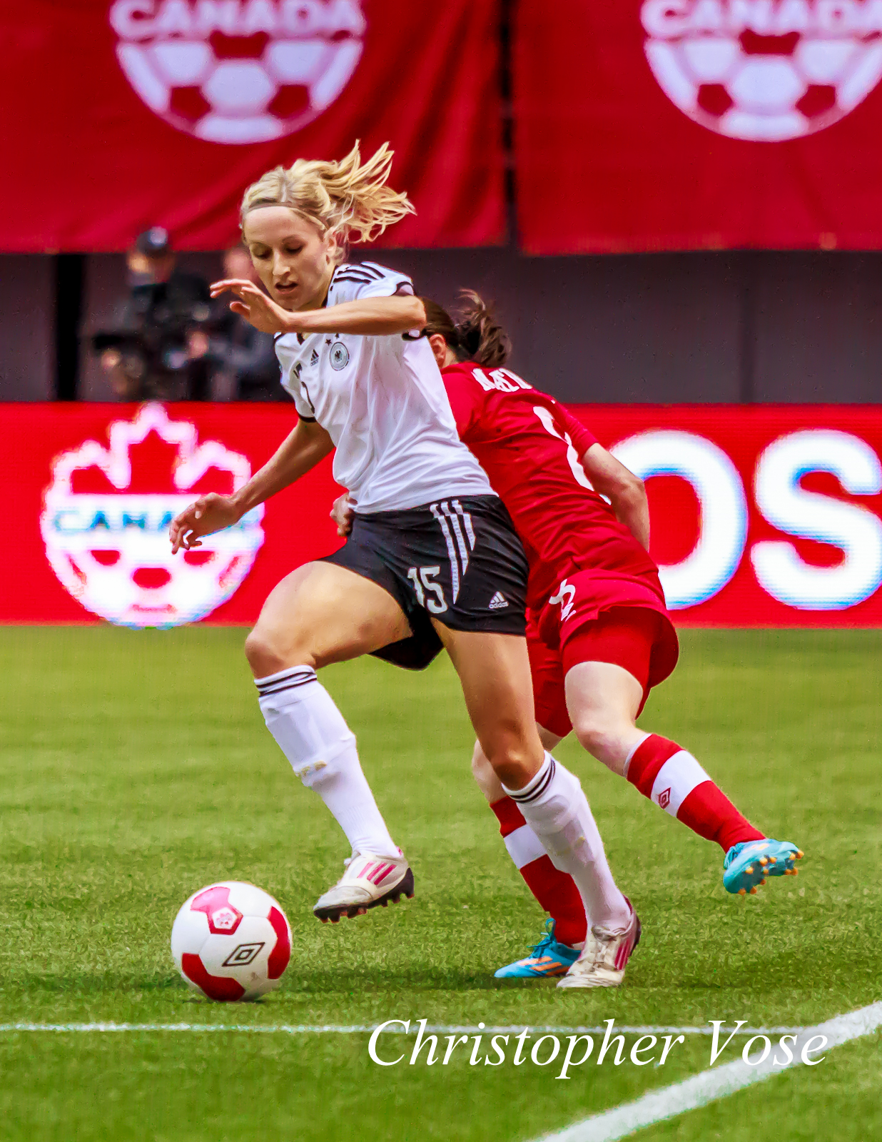 Kathrin Hendrich and Diana Matheson clashed at BC Place on 18 June 2014.