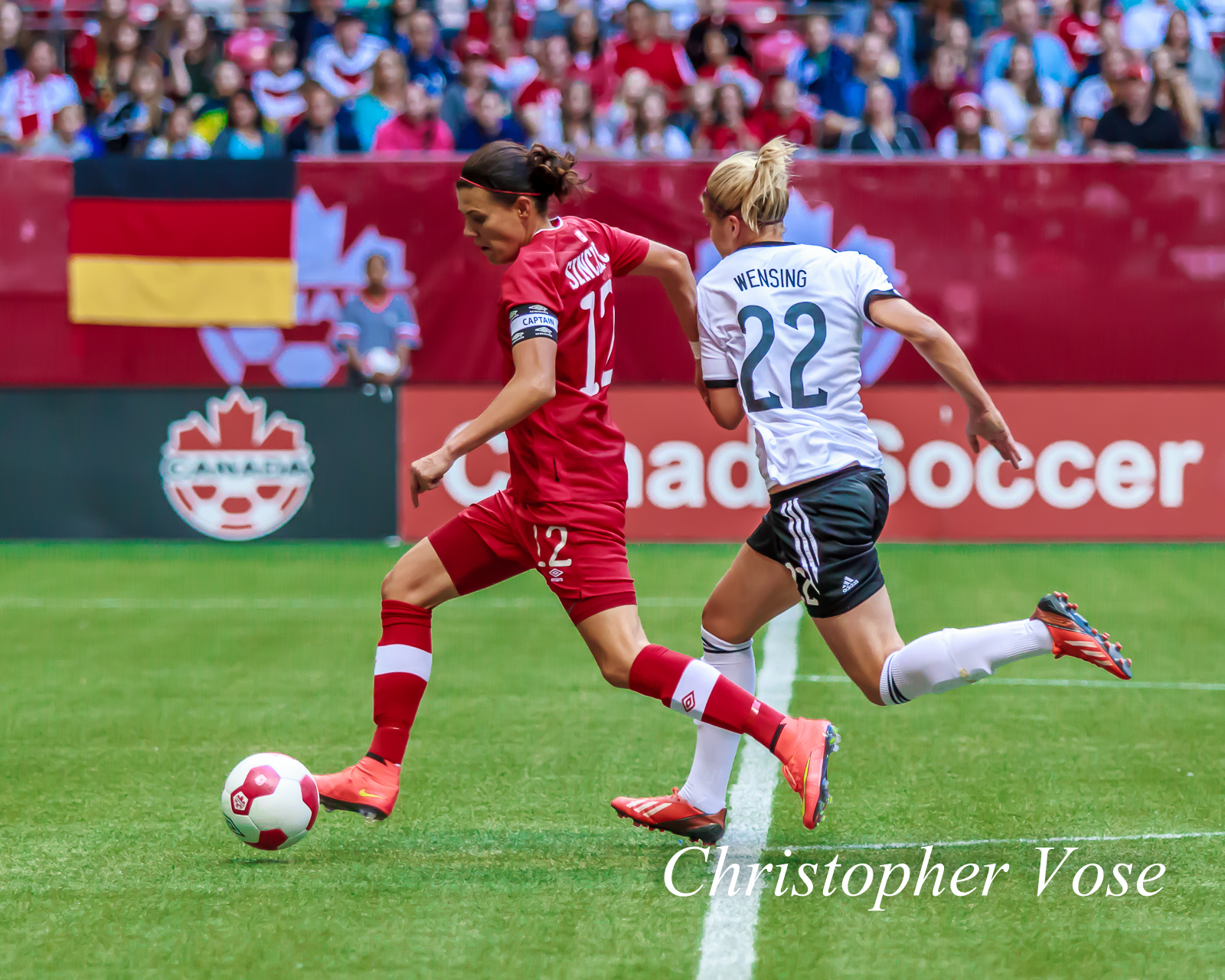 2014-06-18 Christine Sinclair and Luisa Wensing.jpg