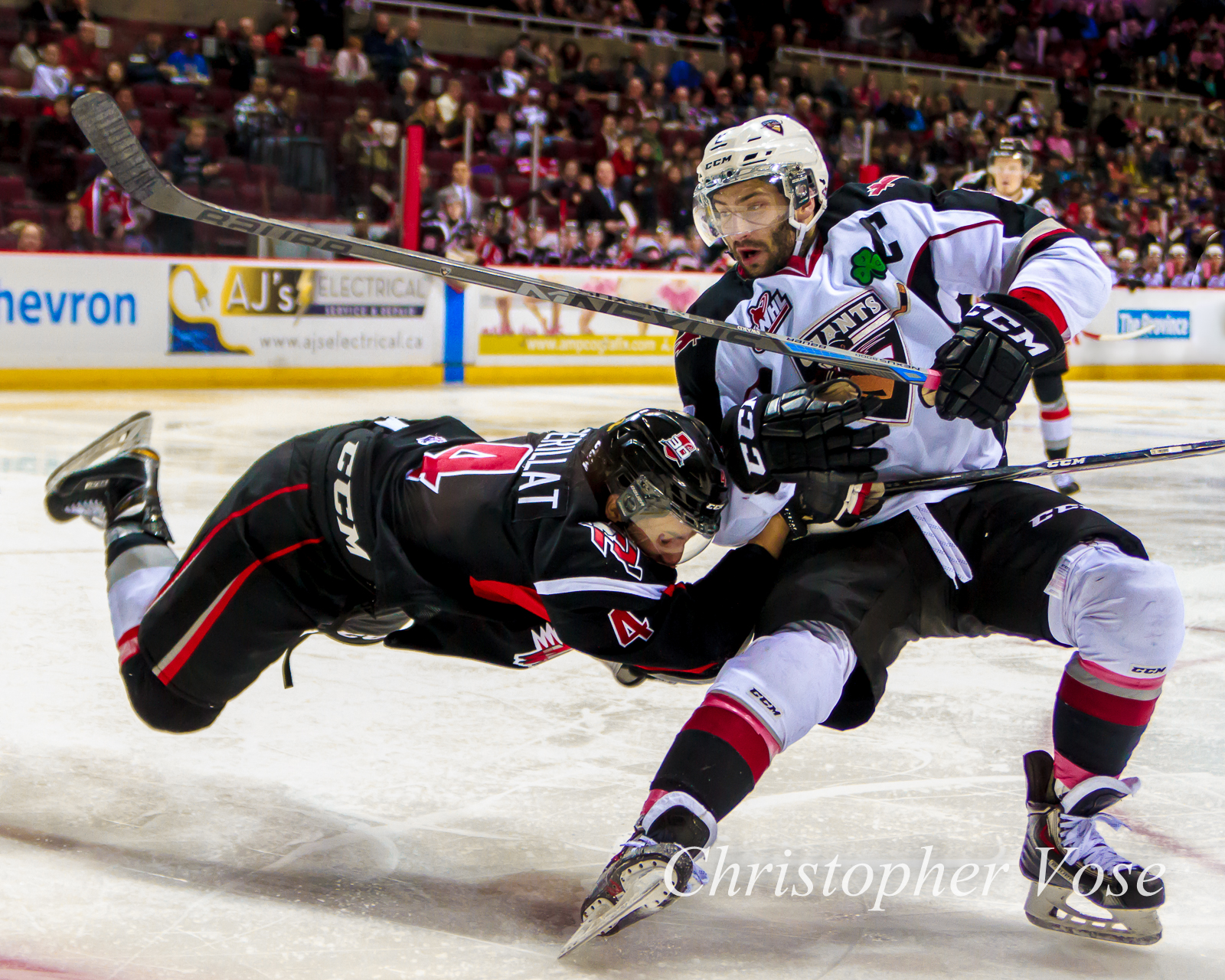 Moose Jaw's Dustin Perillat flies into Vancouver's Dalton Sward at the Pacific Coliseum on Wednesday afternoon.