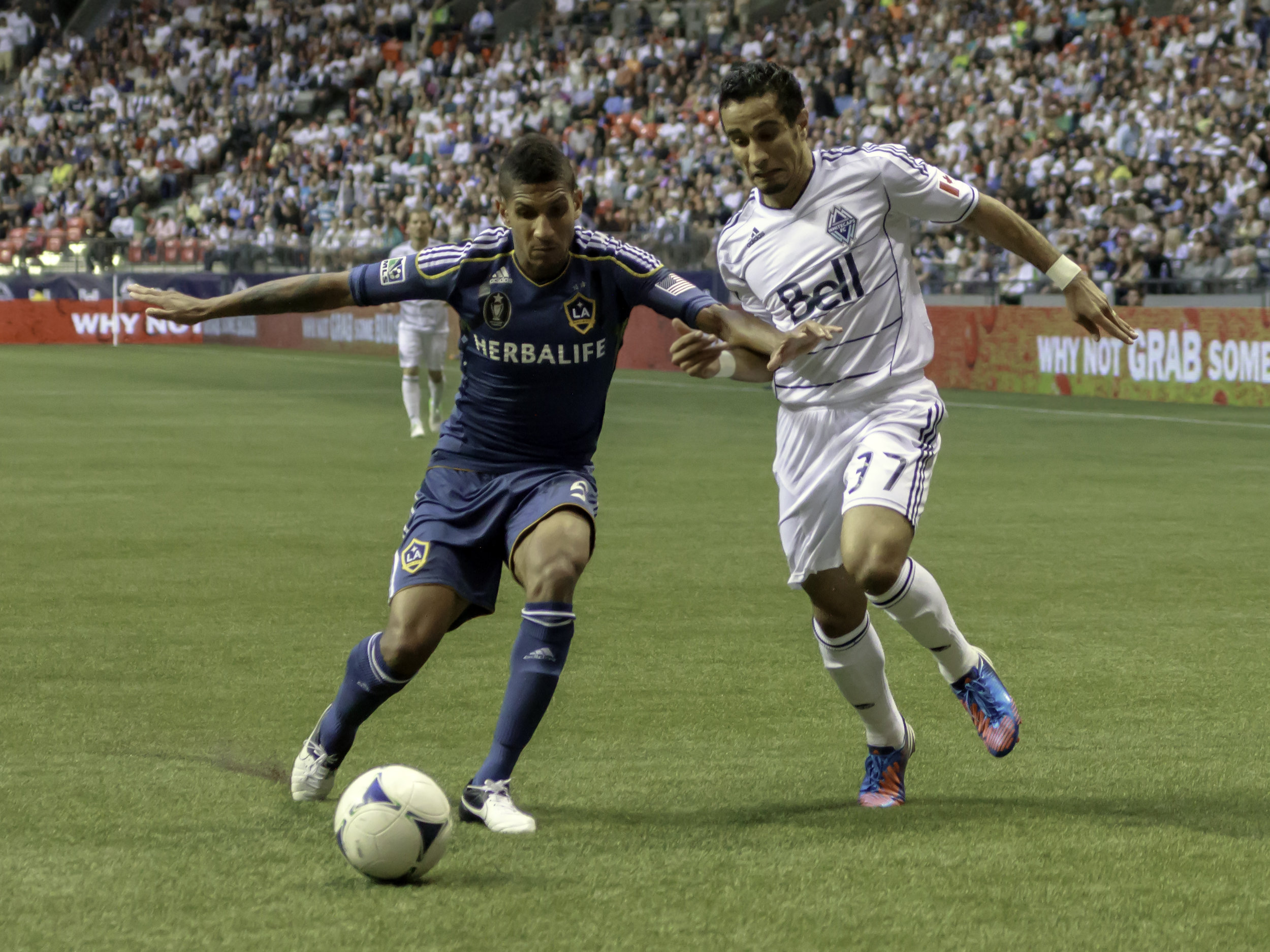 Sean Franklin holds off Camilo Sanvezzo in his first match at BC Place