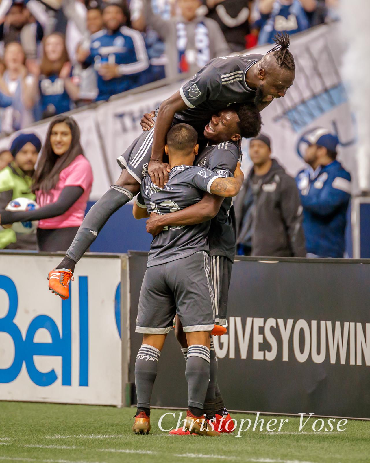 Kei Kamra andCristian Techera celebrate with Alphonso Davies after he put Vancouver up 2-0