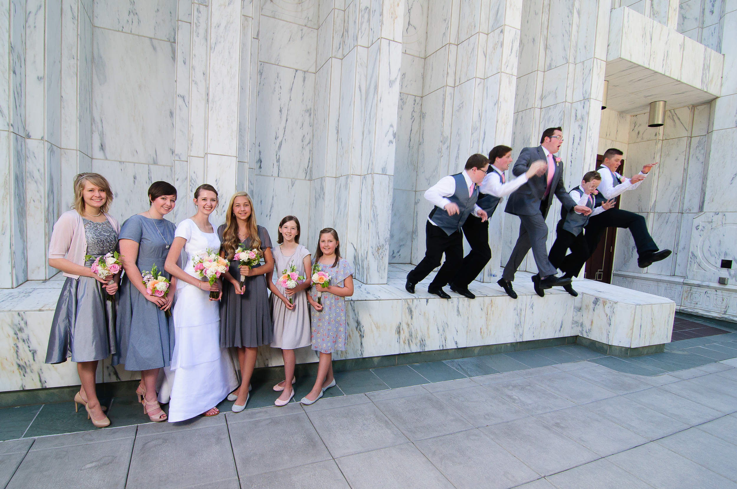 While I was staging the bridesmaids for a group shot my second shooter was jumping the groomsmen. A wide lens meant I could capture both at once.