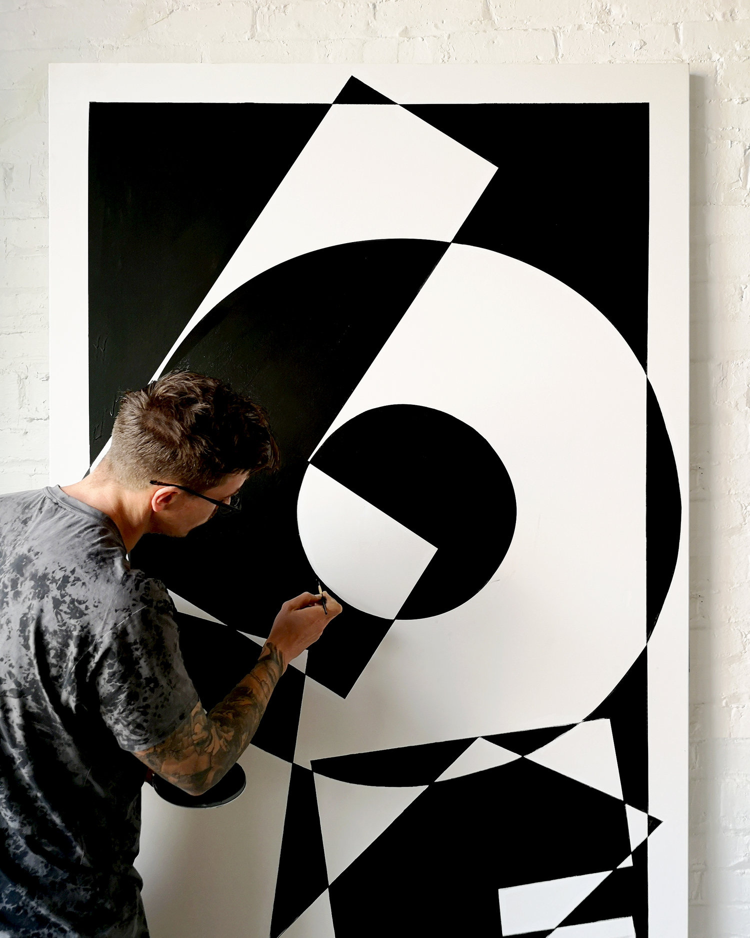 Image of Ben Johnston creating Love mural