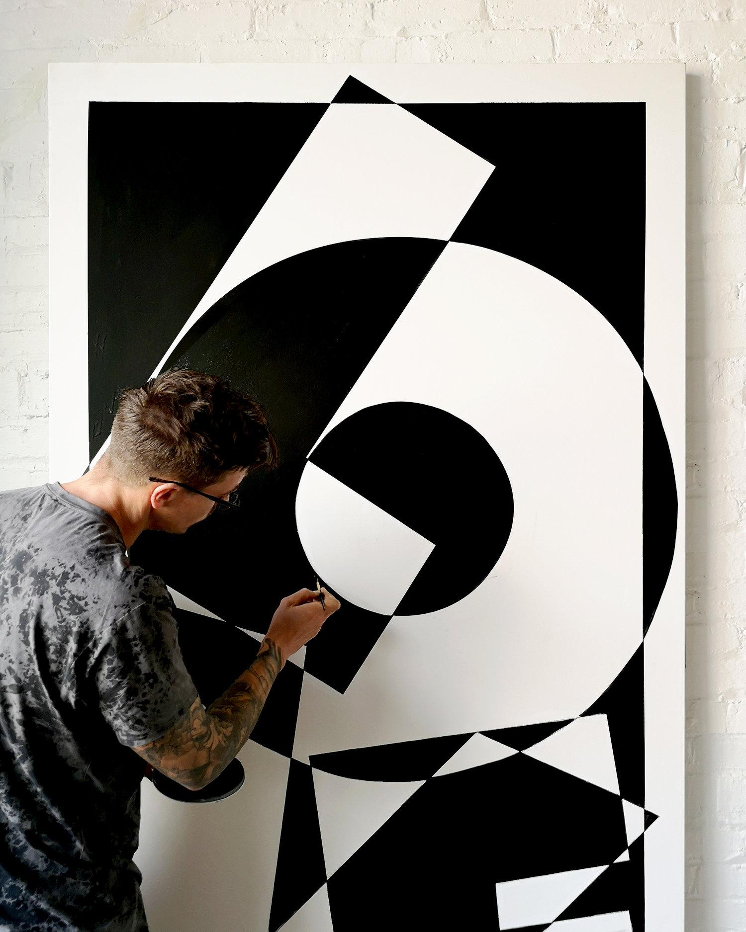 Image of Ben Johnston creating Love mural
